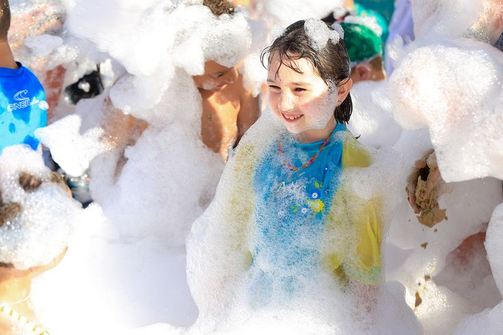 """Our daughter loved the """"Foam Party"""" on the beach. It was like a giant bubble bath."""