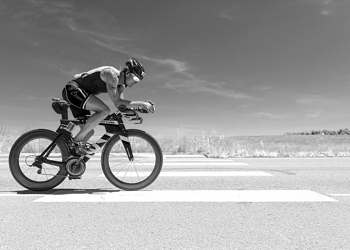 Racer # 2076 at mile 101.5 of 112 on the bike course.  2014 Ironman Boulder. Boulder, CO