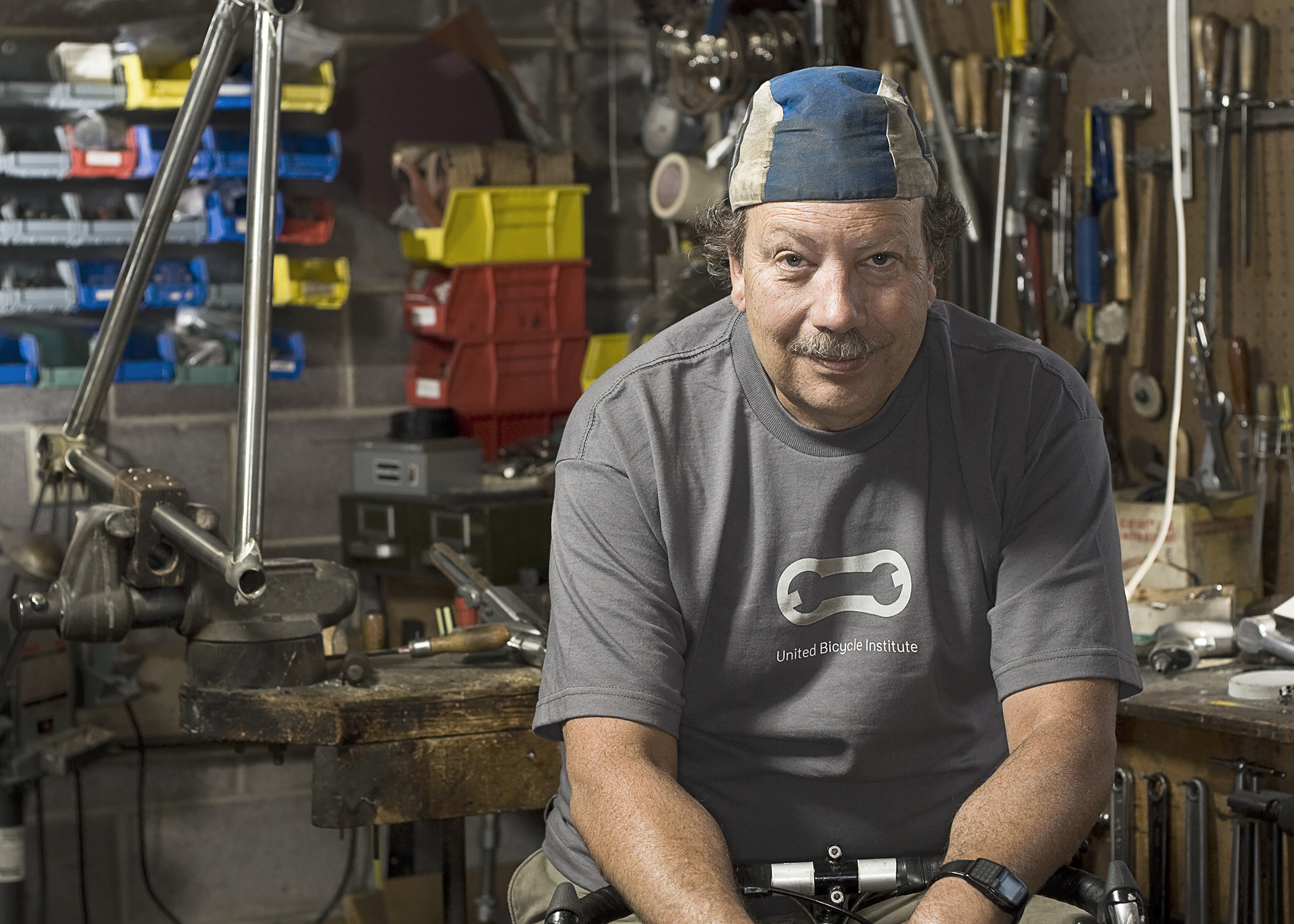 Mark and his Nobilette in his frame building shop for the My Favorite Bike Portrait Series.