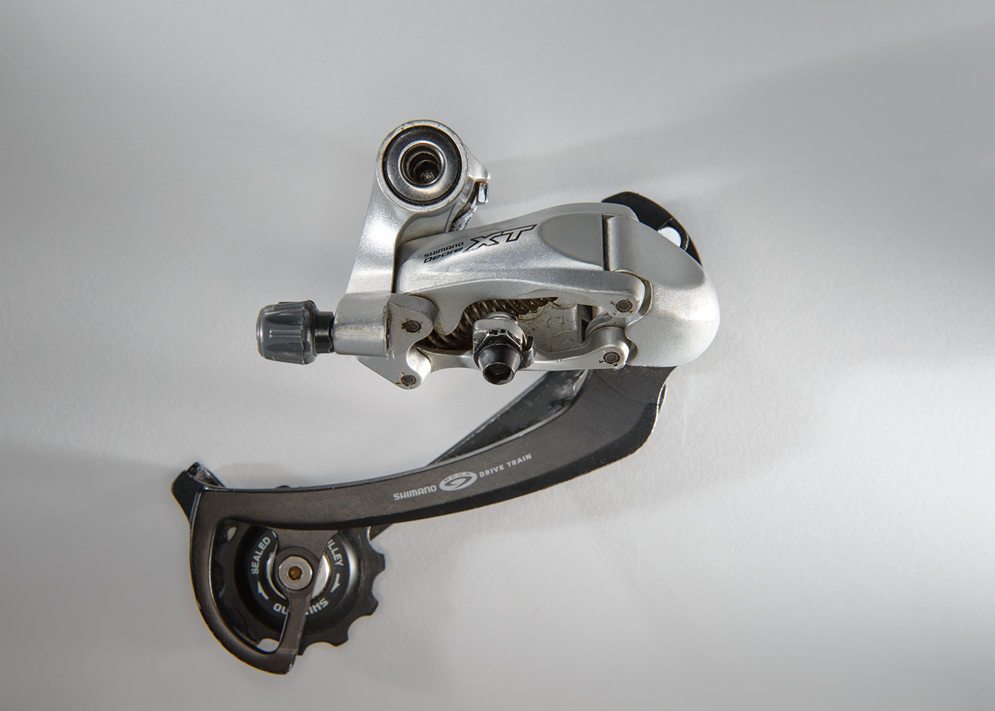 Shimano Deore XT Rapid Rise M760  It was introduced in 2003 and provided a claimed advantage over high-normal derailleurs but alas it did not.