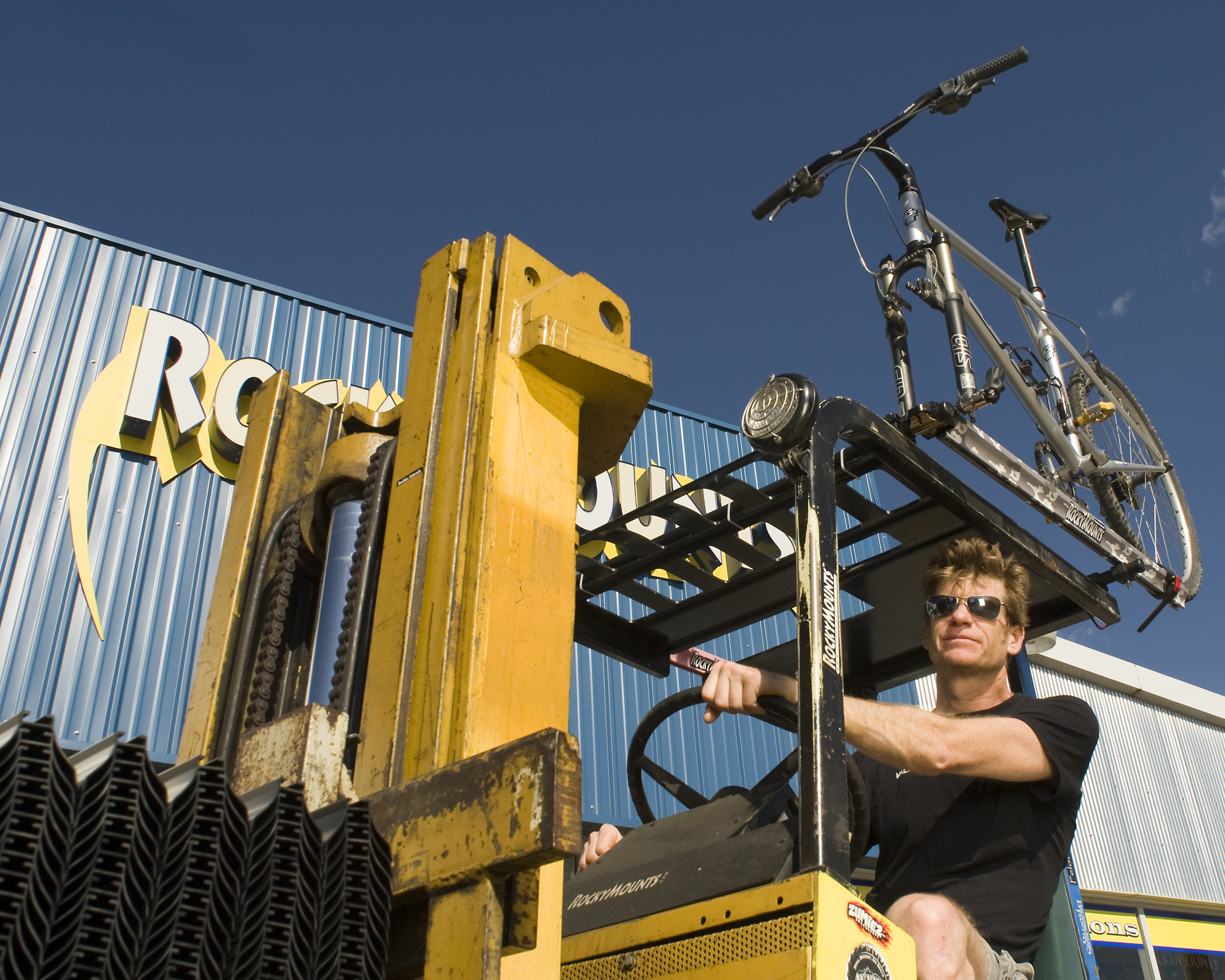 Bobby, his GT and his forklift outside of Rocky Mounts for the My Favorite Bike Portrait Series.