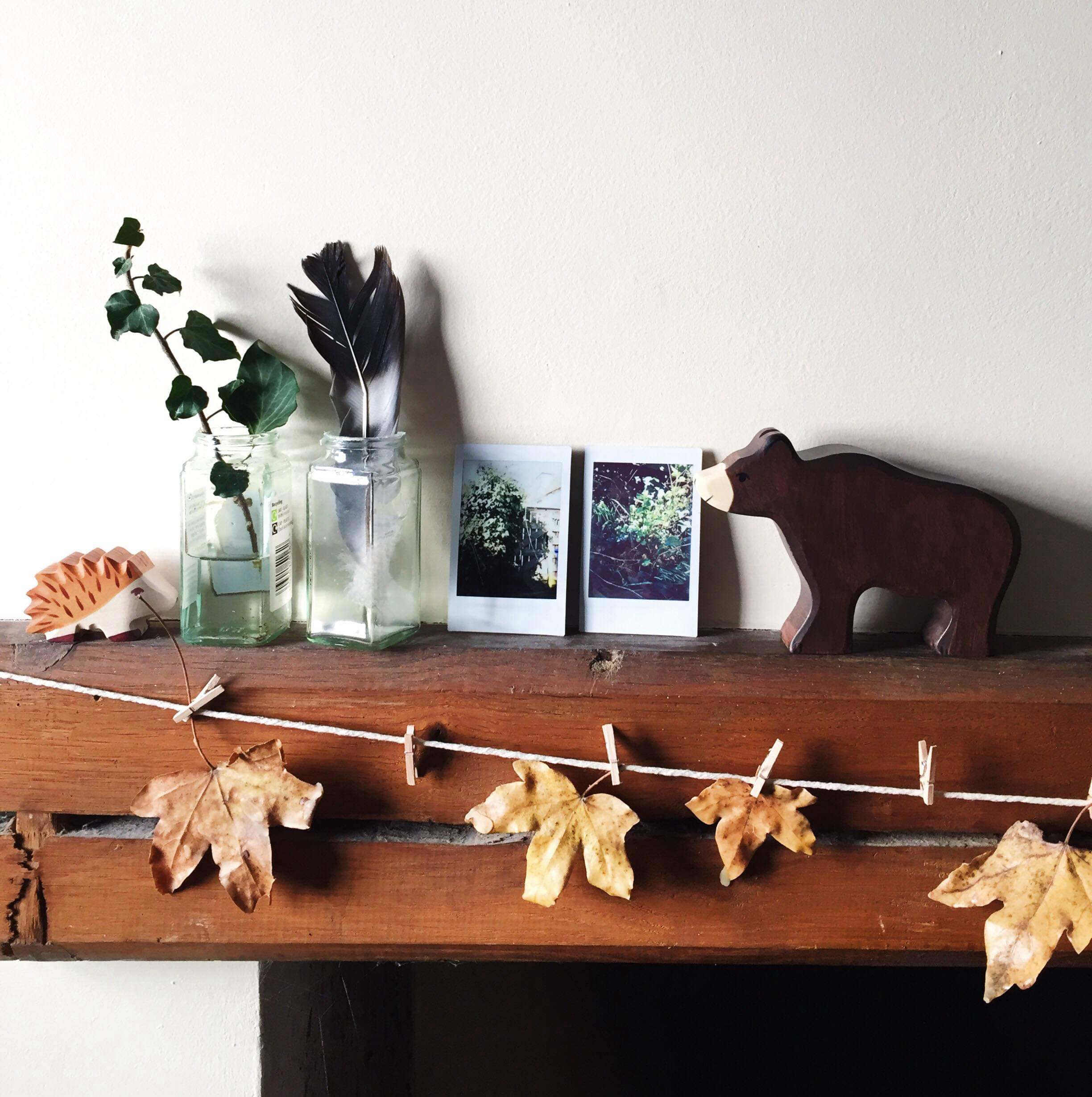 We created this leaf garland over autumn, and made small vases from empty spice jars. Sometimes I take out our polaroid camera for nature walks, and I love the idea of getting Eilish her own little one to record things for herself when she's a little older.