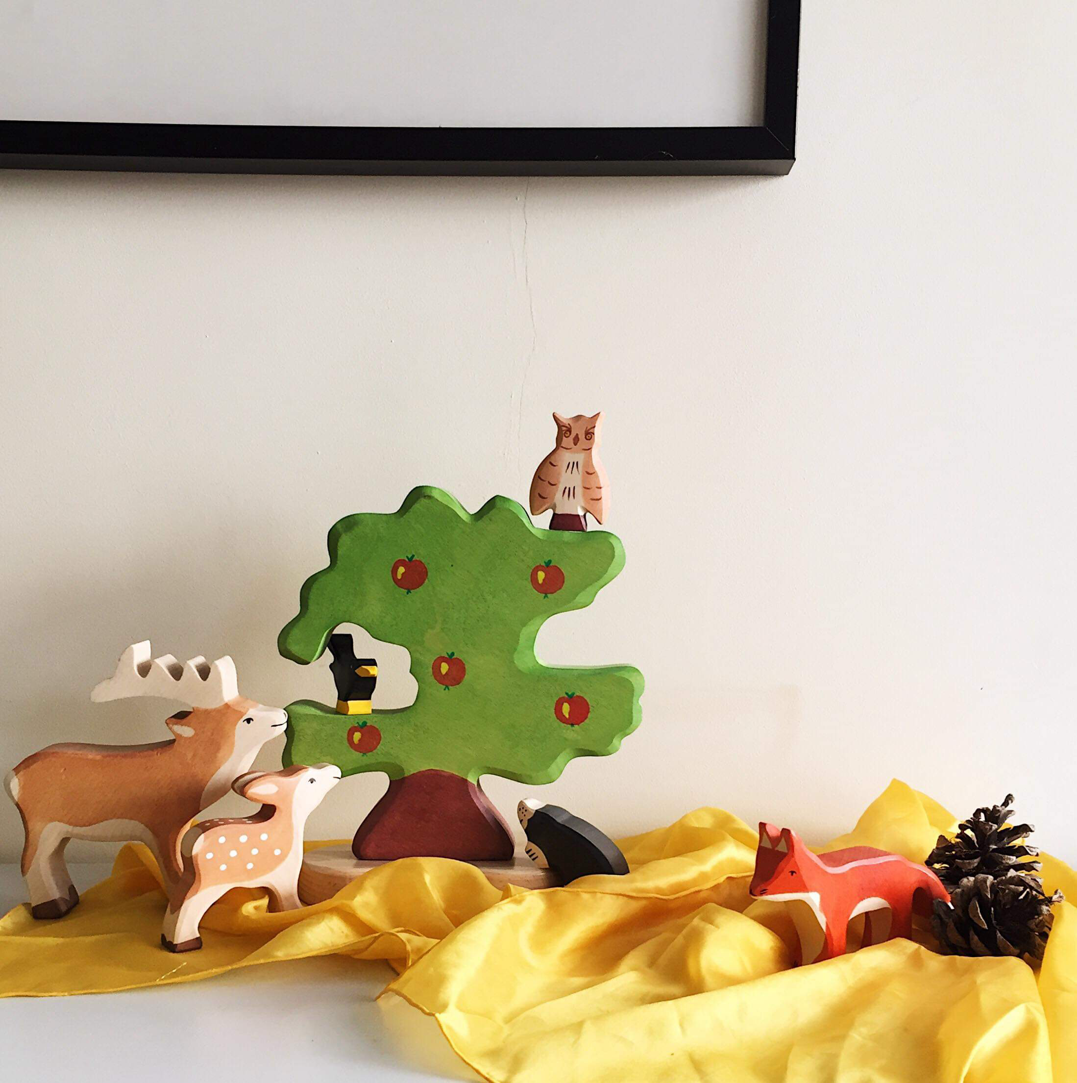 We used a yellow playsilk and a few wooden animals to create an autumnal scene that Eilish loved to play with, as well as gave a nod to the season.