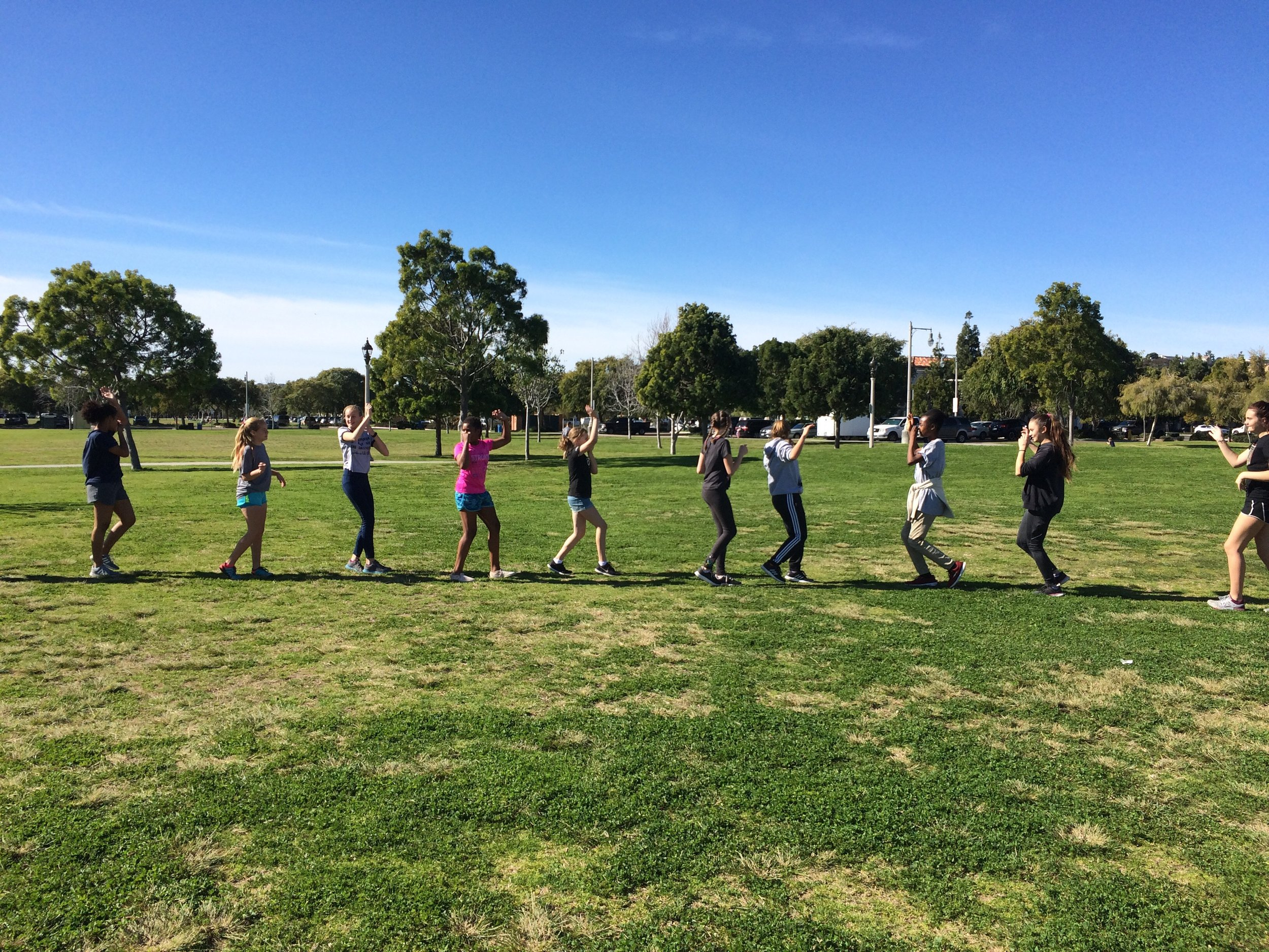 Tween girls empowerment through fun fitness in Liberty Station Park