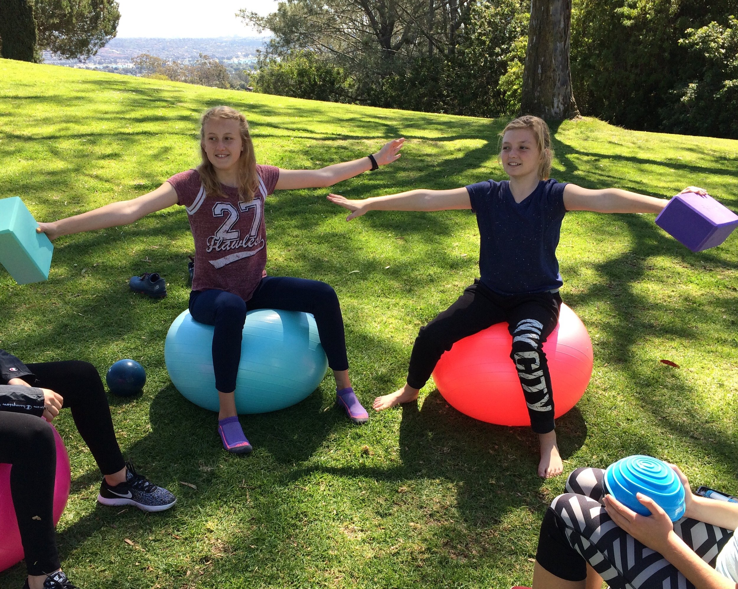 Girls exercising for fun at Kate Sessions Park