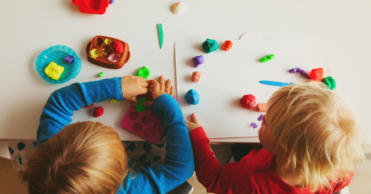young children playing with playdoh