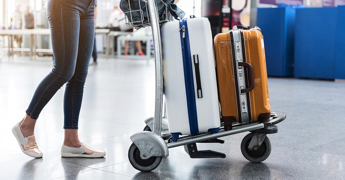 woman pushing luggage