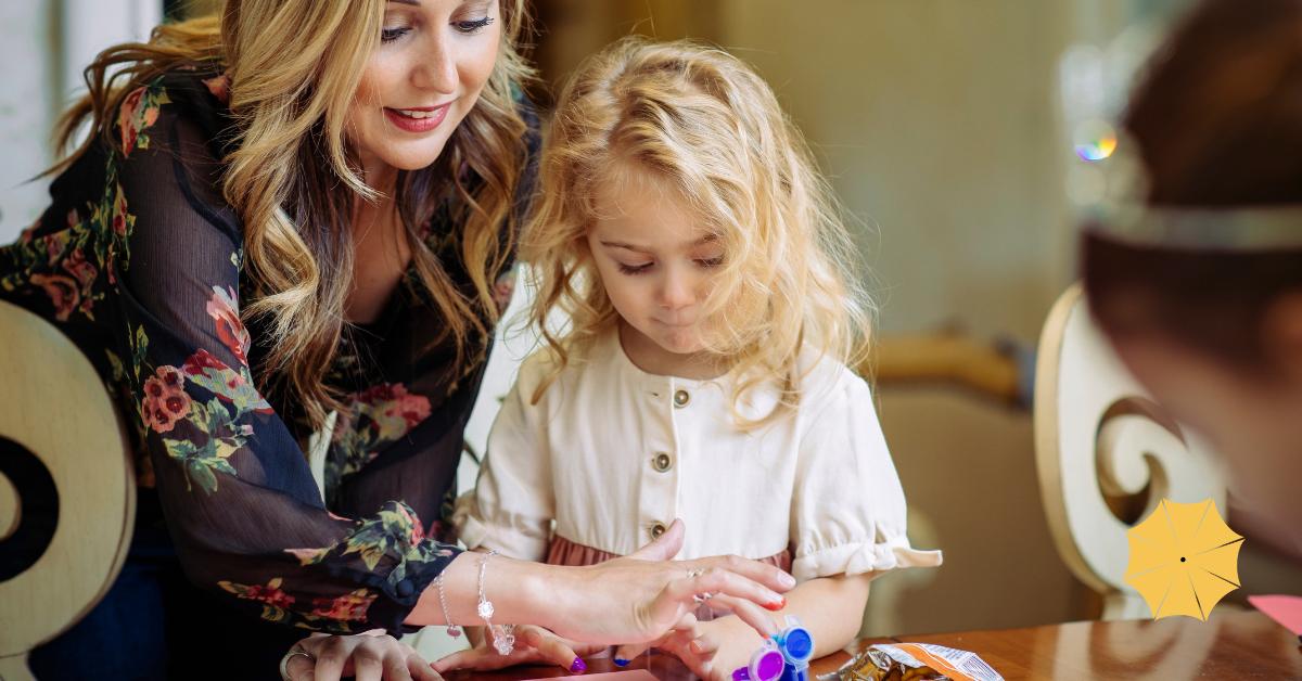 Florence Ann Romano helping a child fingerpaint