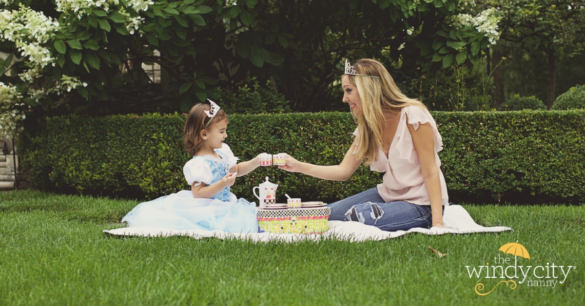 Florence Ann Romano having an al fresco tea party with little girl in a princess costume