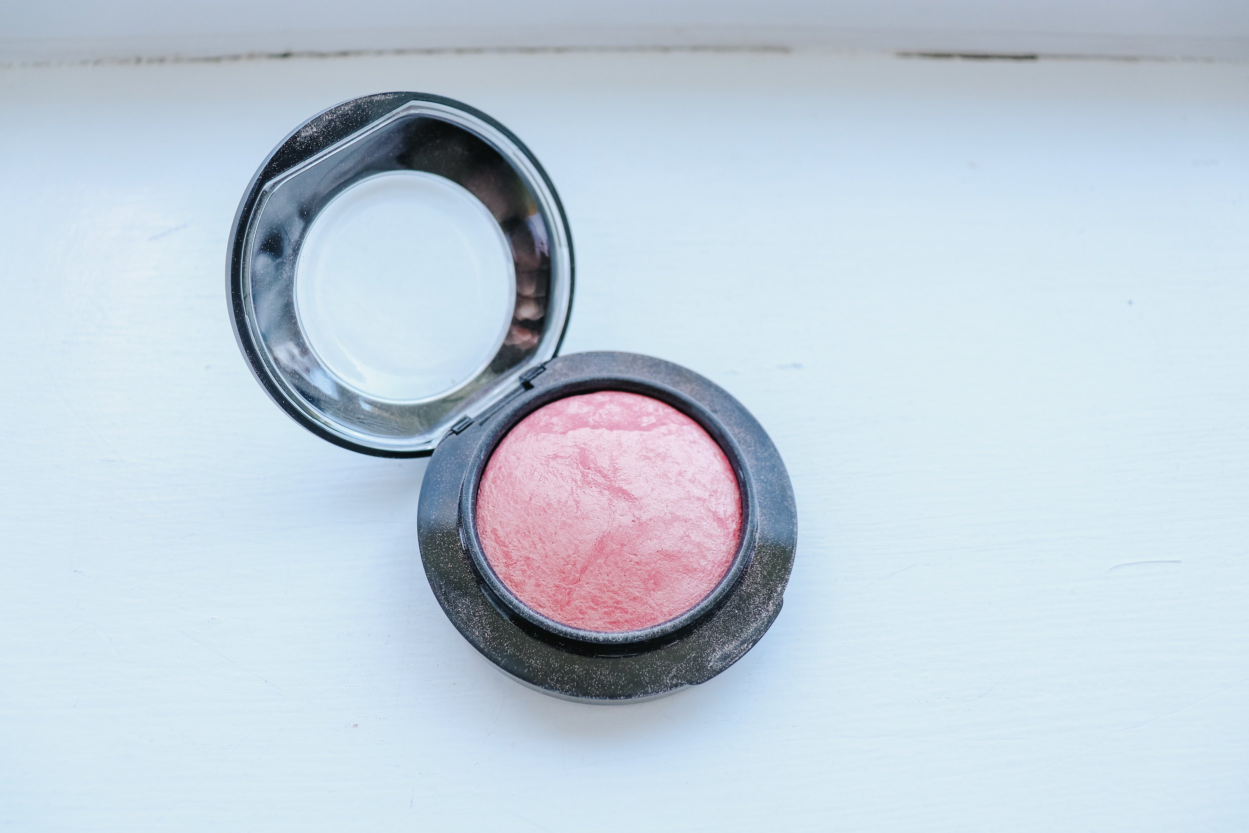 """This photo doesn't even do the color justice! I bought the color """"Petal Power"""", it's a coral pink with gold shimmer in it and it's the BOMB. I love MAC's mineralized blush..they are so natural and look so beautiful on the skin. This color gives you just enough pink and the gold undertones give you a beautiful glow!"""