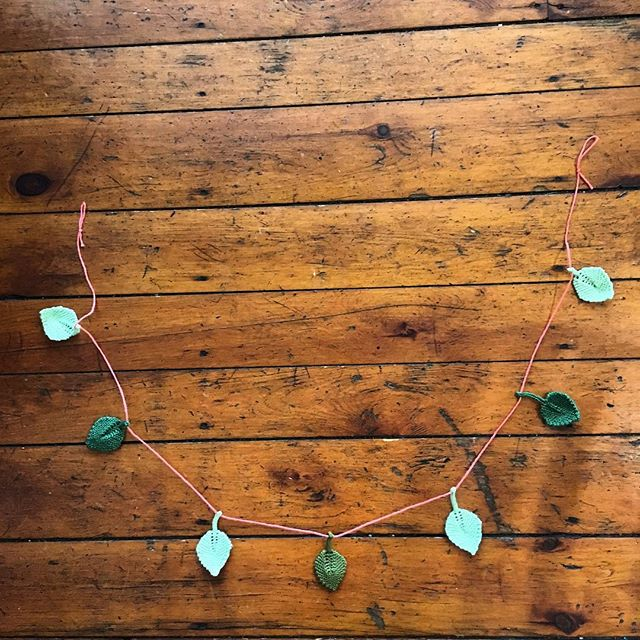 New garland now available! Seven leaves in three shades of green on a pink strand. $35 plus shipping, DM to buy or visit feathersandteacks.com  #fandthandmade #leafgarland #knit #springiscoming