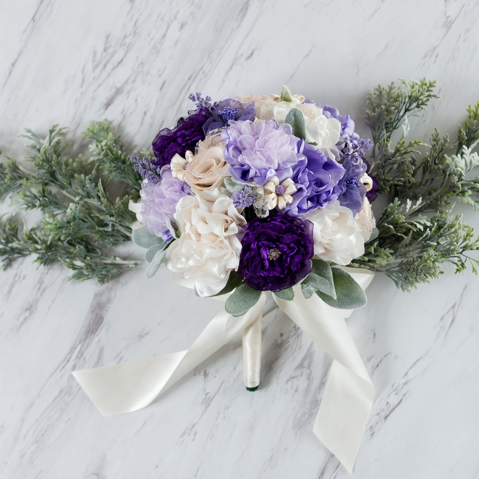 Yours Forever - A Petal and Thread bouquet doesn't just last for your wedding, it's a keepsake you'll enjoy the rest of your life. Display it in your home or save it to pass down to someone special in the future. All arrangements come with a sturdy, decorative box.