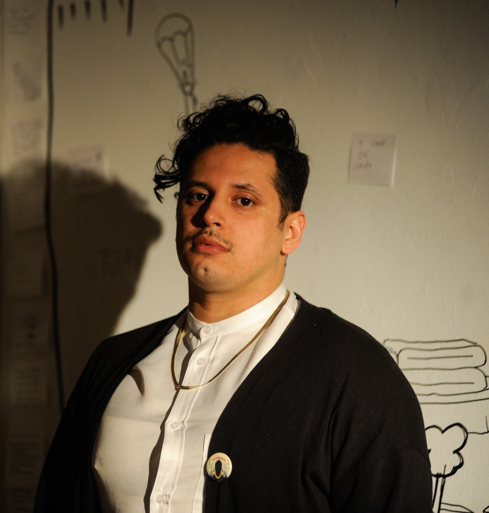 The Players. - Ricardo Gamboa (Founder, Host, Producer) is an award-winning artist, activist, and academic working in their native Chicago and New York City, creating radically politicized work. In Chicago, Ricardo is a member of the Free Street Theater, the Goodman Theater Playwrights Unit, a resident playwright at Chicago Dramatists, and founding adult creative partner of the controversial, politically-charged ensemble The Young Fugitives. In New York City, they are a fellow of the EmergeNYC program at Hemispheric Institute of Performance and Politics and a member of the New York Neo-Futurists. They are finishing their doctorate degree at New York University's renowned American Studies program and are a Critical Collaborations Fellow (2016-2018) at the Tisch School of the Arts, where they received their M.A. in Arts Politics (2013). Ricardo has won several awards including a Joyce Award and an International Connections Award from the John D. and Catherine T. MacArthur Foundation. They have worked with over 5,000 young people in the hemisphere. Their current projects include the underground live news show and podcast The Hoodoisie, the audience- and critically engaged, community-based theater piece Meet Juan(ito) Doe and BRUJOS, the genre-bending, ground-breaking web series about four gay Latino doctoral students who are also witches (co-directed with Reshmi Hazra Rustebakke and Robert Stockwell).