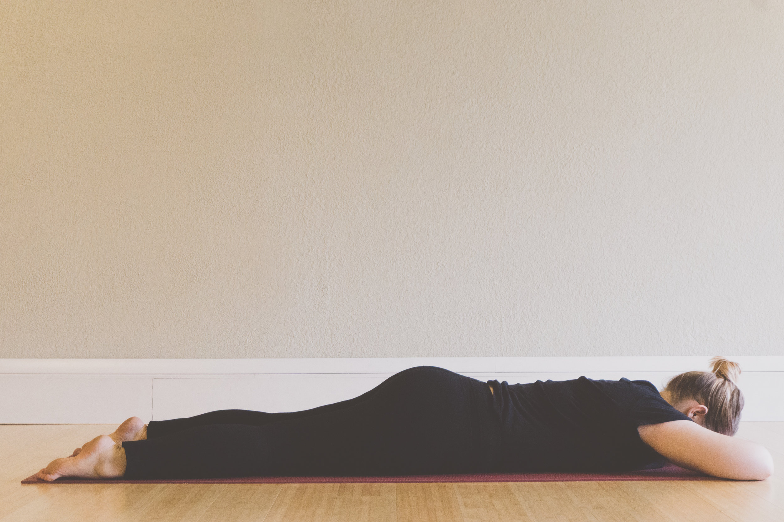 crocodile pose - For crocodile pose lie on your stomach. Stack your hands under your forehead using the back of your hands as a pillow. Let your feet turn out. Relax completely, and breathe deeply. Let your belly and low back move as you breathe. Stay for 6-8 breaths or more.