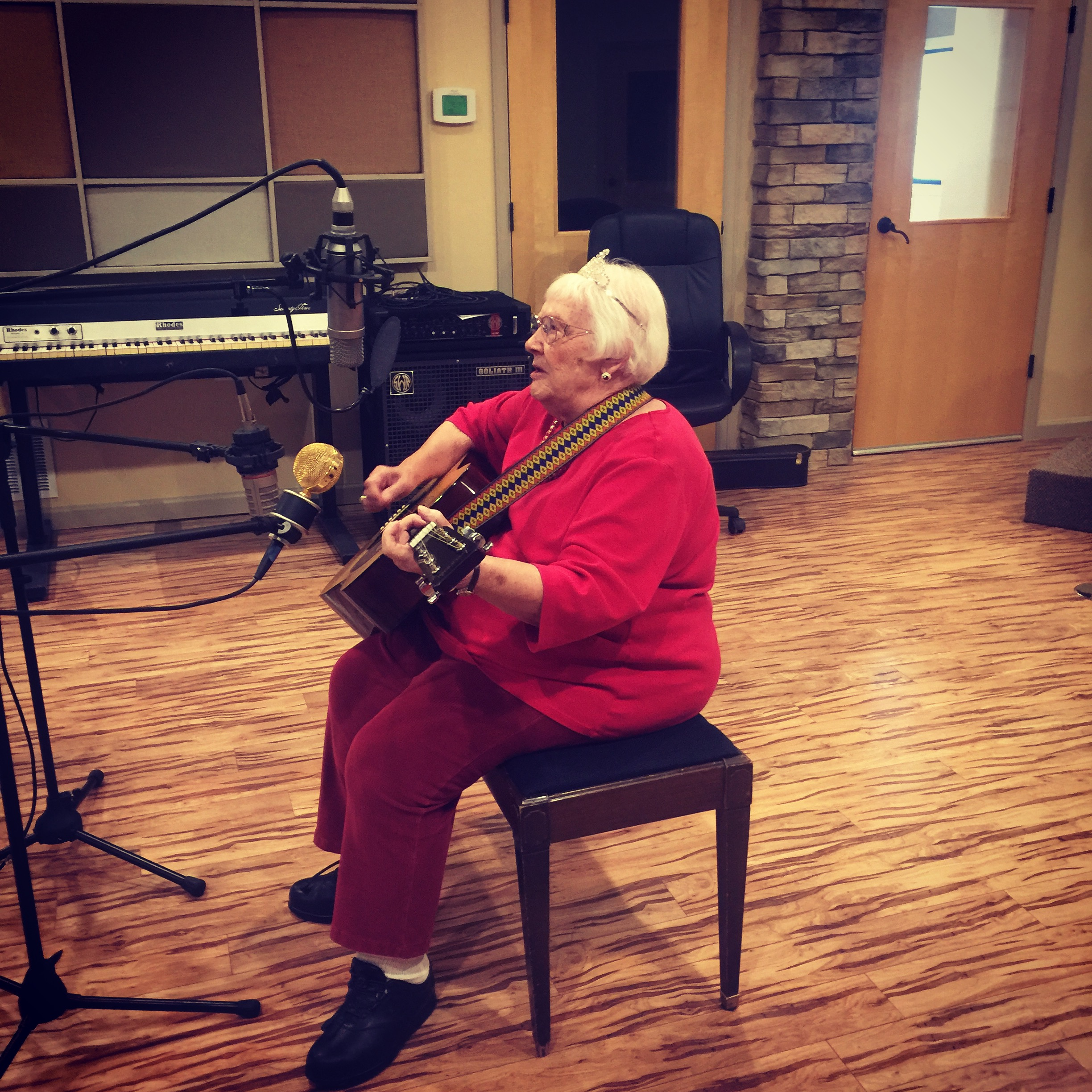 "89-year-old fulfills lifelong musical dream by recording song in professional studio - BY JON POMPIA THE PUEBLO CHIEFTAIN Published: October 17, 2016; Last modified: October 17, 2016Some want to fly in a hot air balloon or ride a zip line. Others ask for a familyreunion or to take in a major league sporting event.But not Mary Ward.She just wants to jam. Thanks to the Wish of a Lifetime, which fulfills long-held dreams of seniors, the spry 89-year-old resident of Brookdale El Camino, a runner-up in this year's Silver Queen pageant, spent Monday afternoon, in the parlance of old school recording artists, ""putting it on wax.""At Carl Lucero's state-of-the-art Perfect World recording studio,Ward, acoustic guitar in hand, cut a version of a song she first learned from her mother as a young child.Entitled ""The Burglar Song,"" it's a witty, countrified ditty about a burglar who breaks into the home of an unsightly old maid and begs to be shot rather than give in to her amorous demands.While Ward obtained a copyright on the tune years ago at the encouragement of her husband — ""He told me if I didn't then somebody else probably would"" — she never had the opportunity, nor funds, to professionally record it.But that all changed with an application to Wish of a Lifetime, submitted by Janella Sandoval, executive director of Brookdale El Camino.""I've been singing all my life and even though I thought about it as a kid, I never had a chance to record anything,"" Ward said. ""But there's a lot of people who want copies of my song — my kids, grandkids, lots of people at Brookdale."" While Lucero tested the levels on a trio of microphones set up to capture Ward's voice and guitar, she ran through the song like it was nobody's business but her own.And the grass-roots magic wasn't lost on Lucero, who is no stranger to recording big-timers.""You are amazing, girl! My gosh, I can't believe it. Seriously, I wasn't expecting that.""""What were you expecting?"" Ward responded.""You play better than the guys in my band ... but don't put that in the paper,"" Lucero said with a wide smile. ""I work with a lot of people and I'm telling you, I love what you're doing.""And hopefully after hearing Ward's record, many more will follow suit.""I guess the lesson is never to give up on your dream,"" said Ward. ""I started singing when I was 8 years old and always wanted to record a song back then.""But I sure didn't think about it much at 89 years old!""jpompia@chieftain.com"