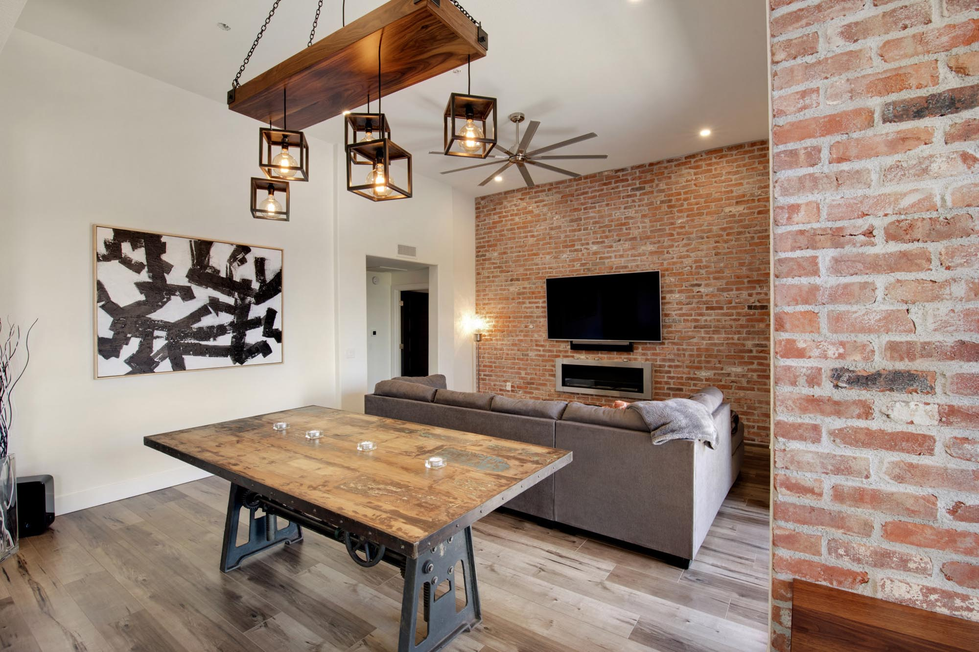 Living room with television on red brick wall