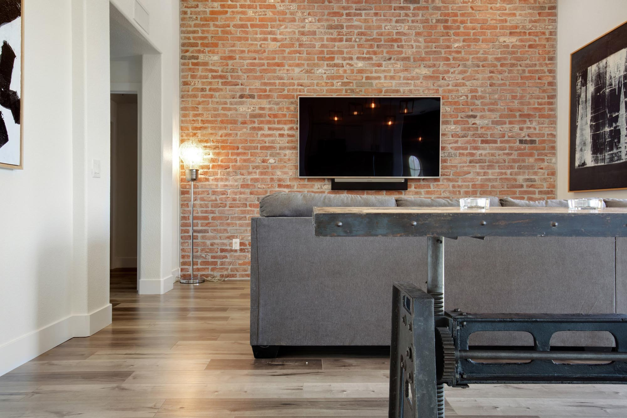 Living room with television and floor lamp