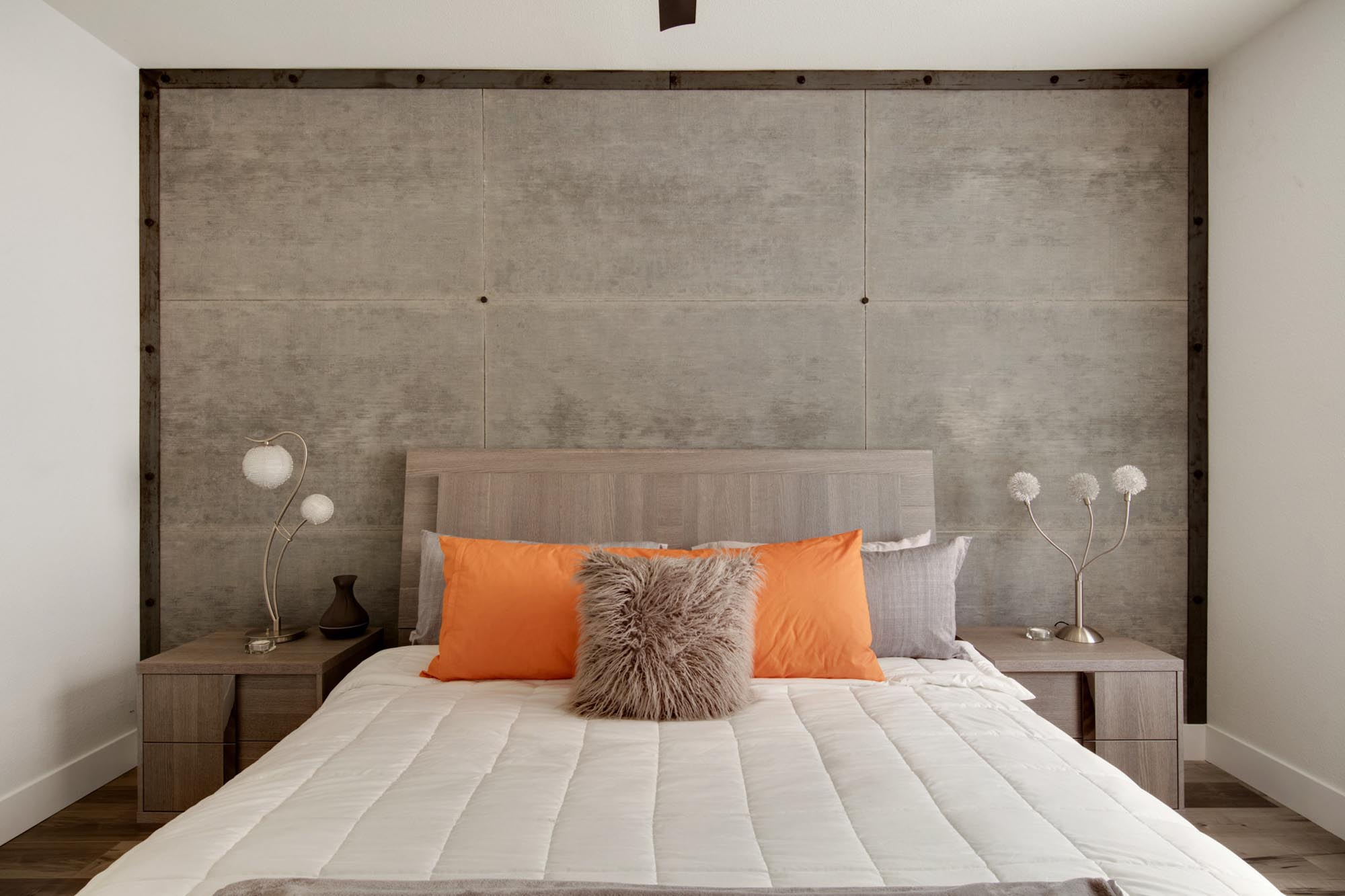 Modern style bedroom with double size bed and stylish lamp shed