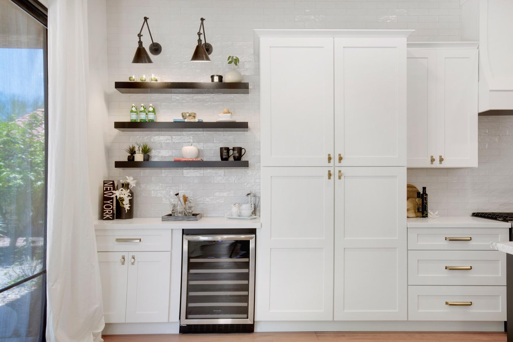 White cabinets and black shelves with decorations