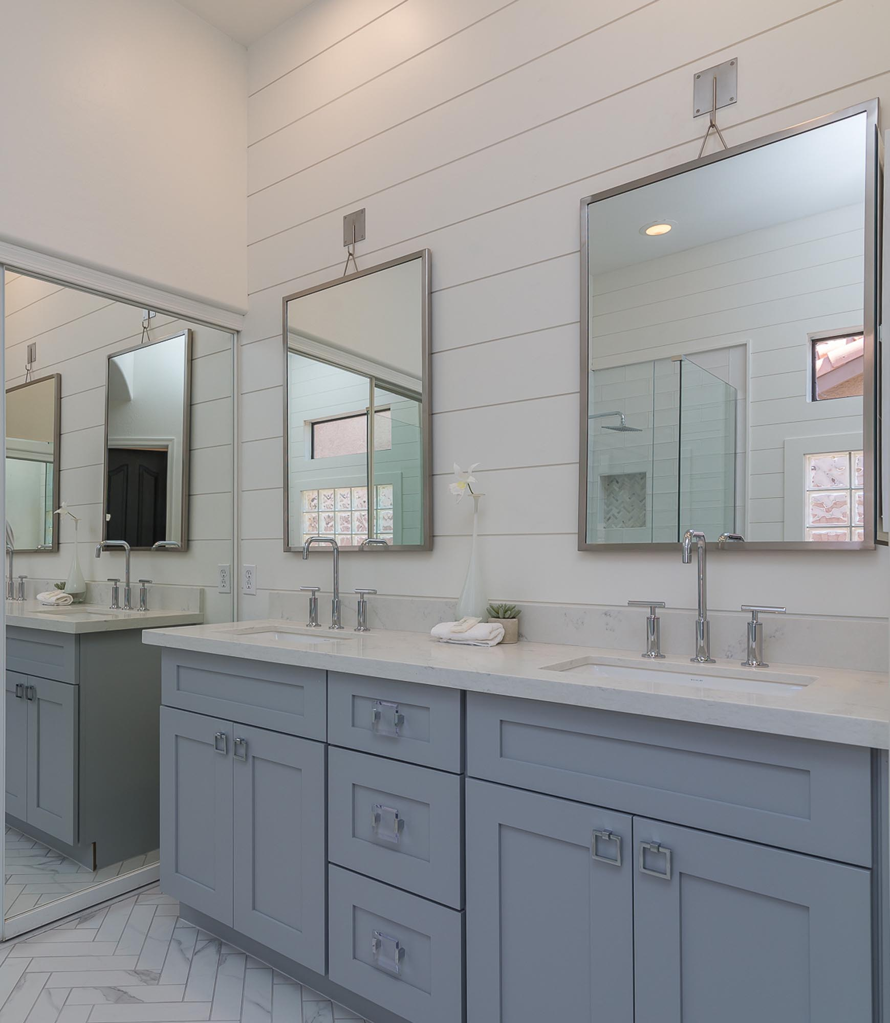 Bathroom washing area with two large mirrors