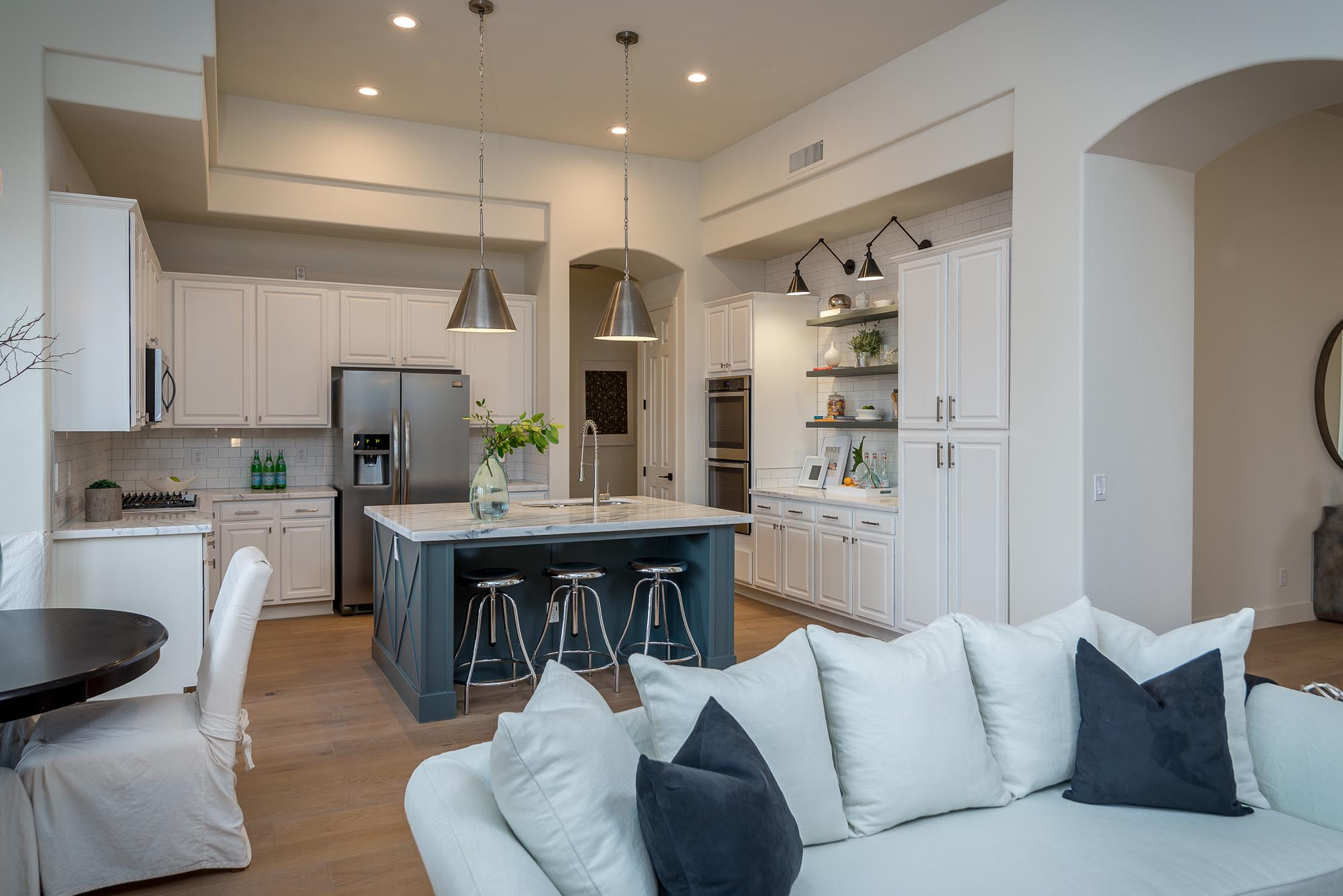 Kitchen with stainless steel appliances and hanging lights