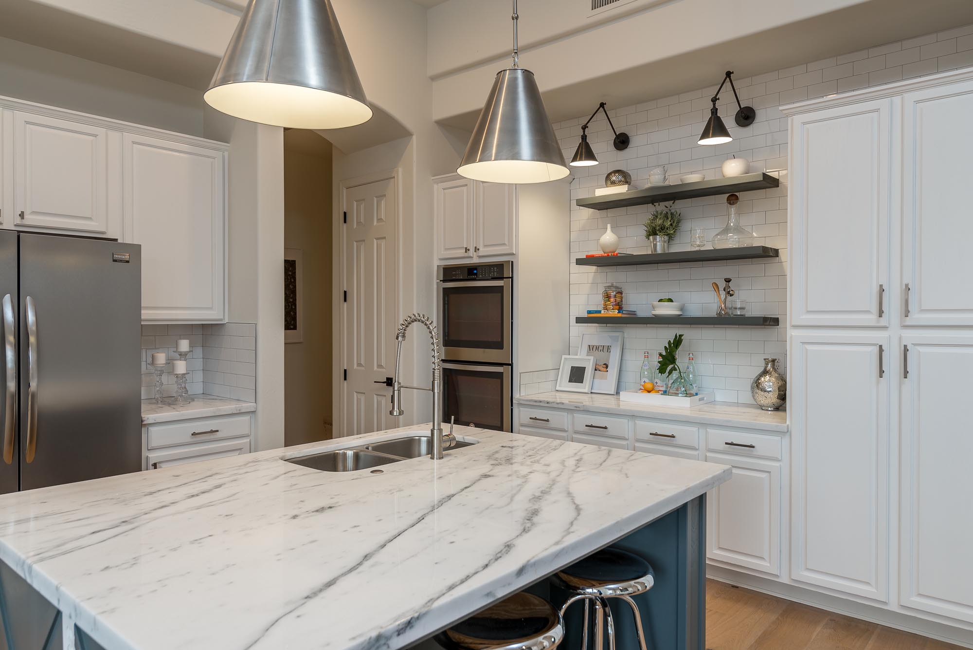 Kitchen with island sink and stylish hanging lights