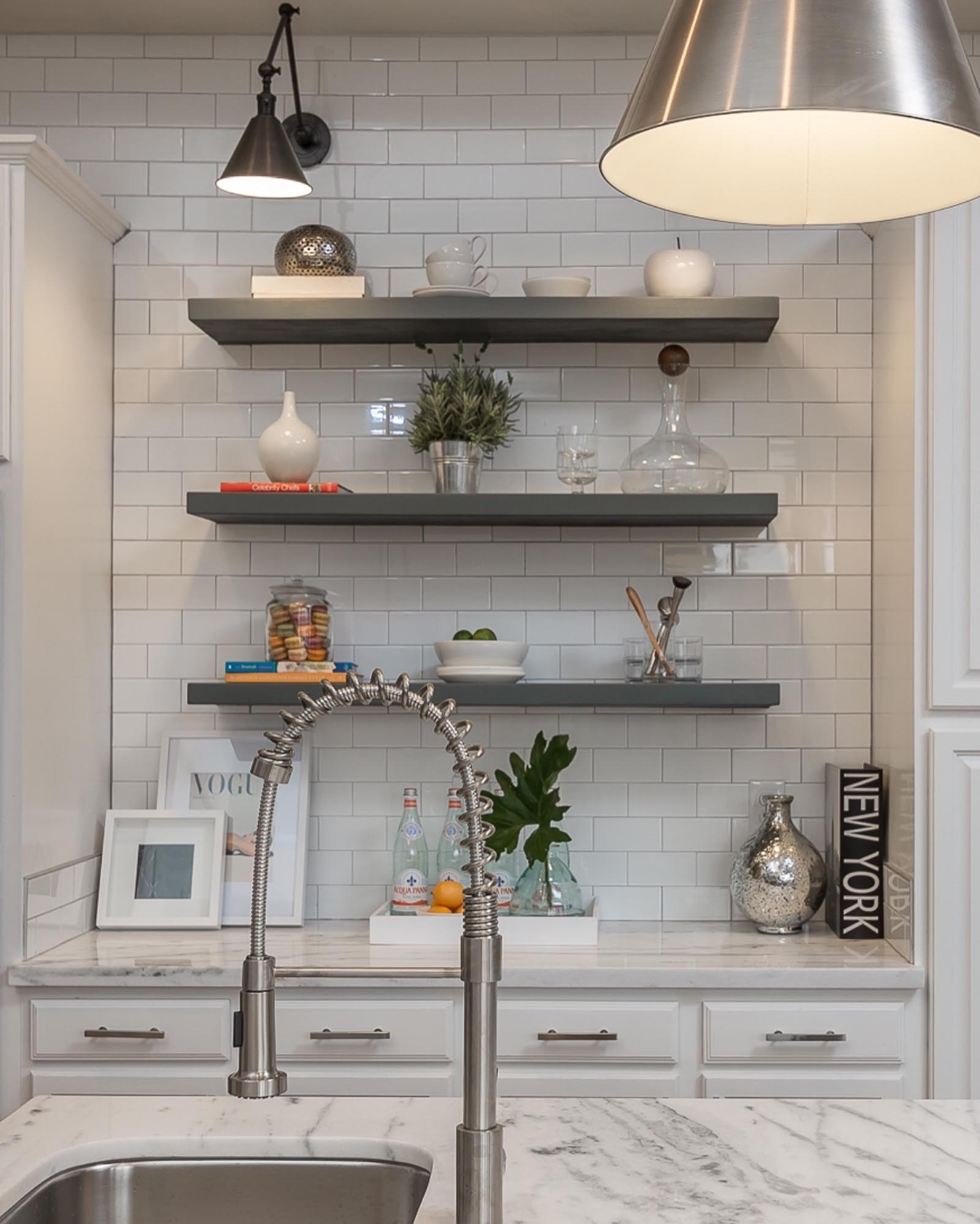 Kitchen with gray shelves and decorations on white wall