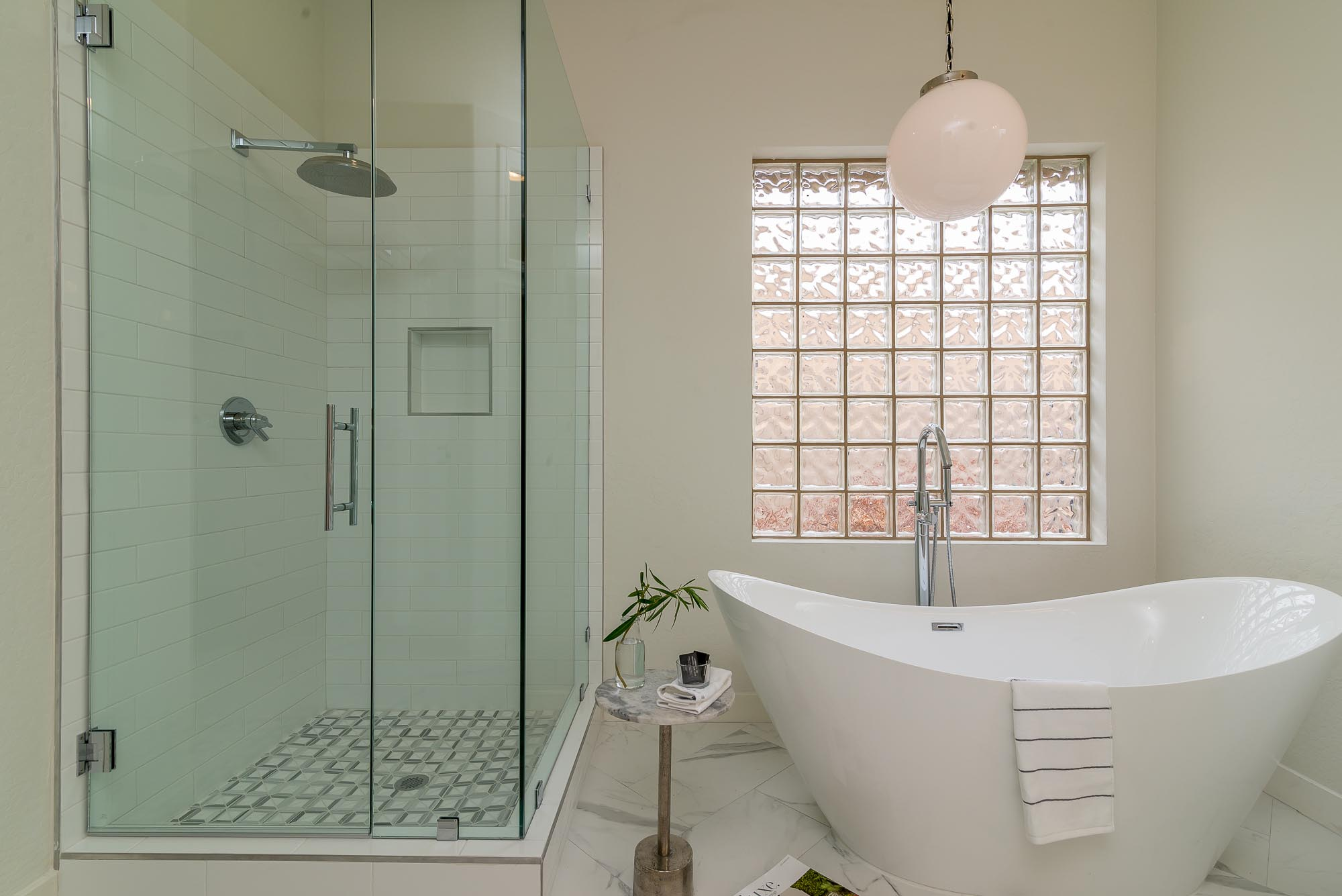 Bathroom with bathtub and glass shower room