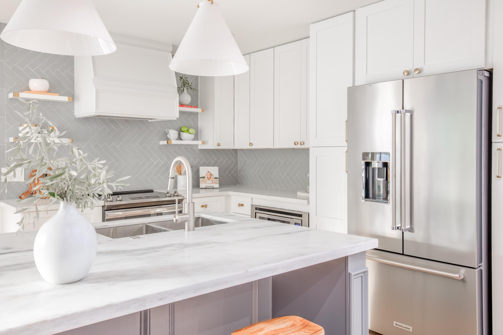 Modern kitchen with white cabinets bar style countertop island