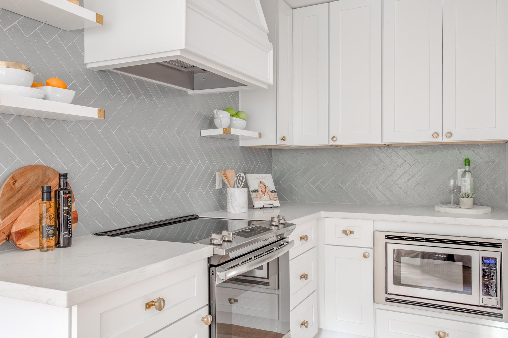 Kitchen with white cabinet and shelves utensils
