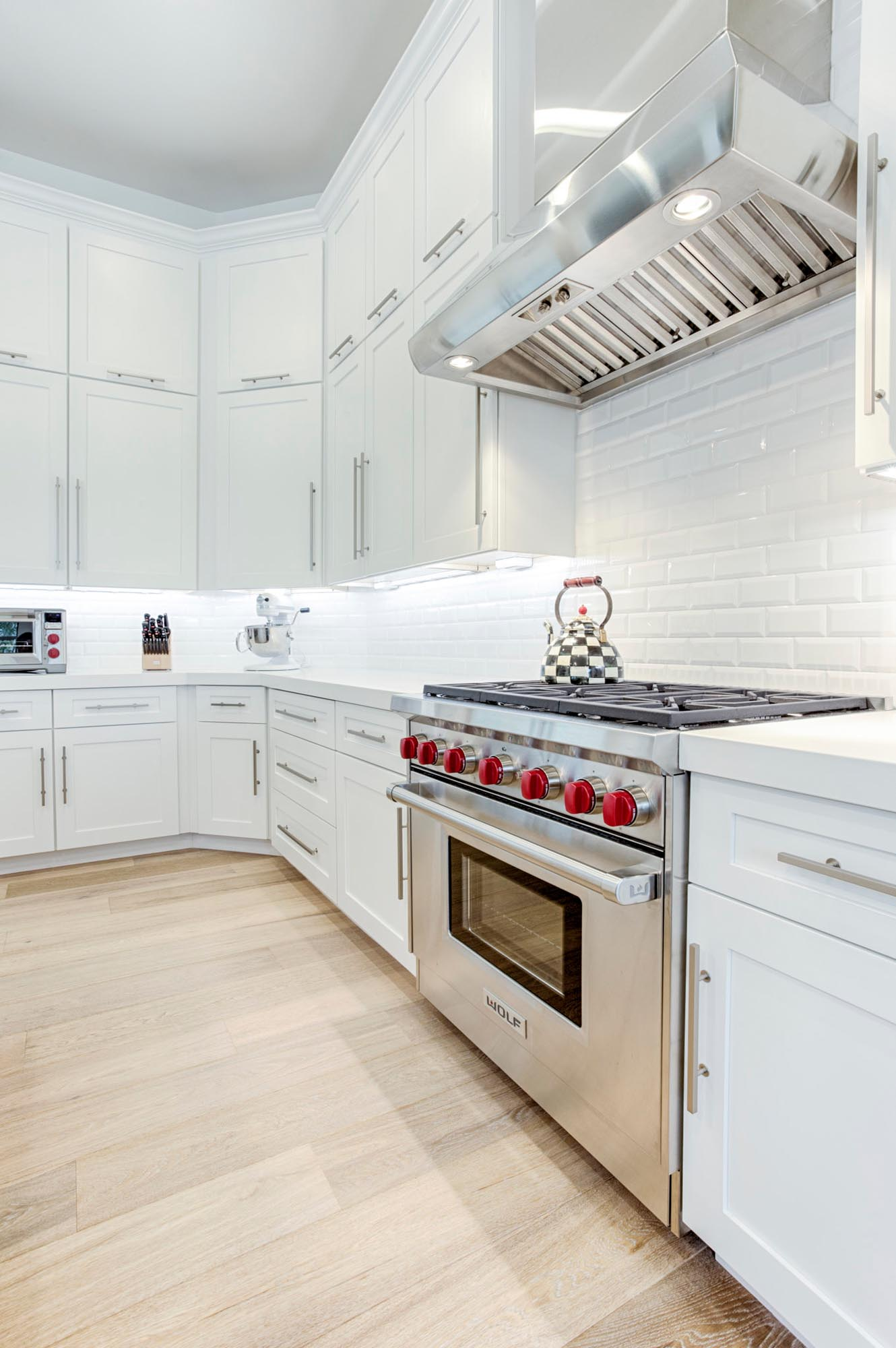 Kitchen white cabinets and stainless steel appliances