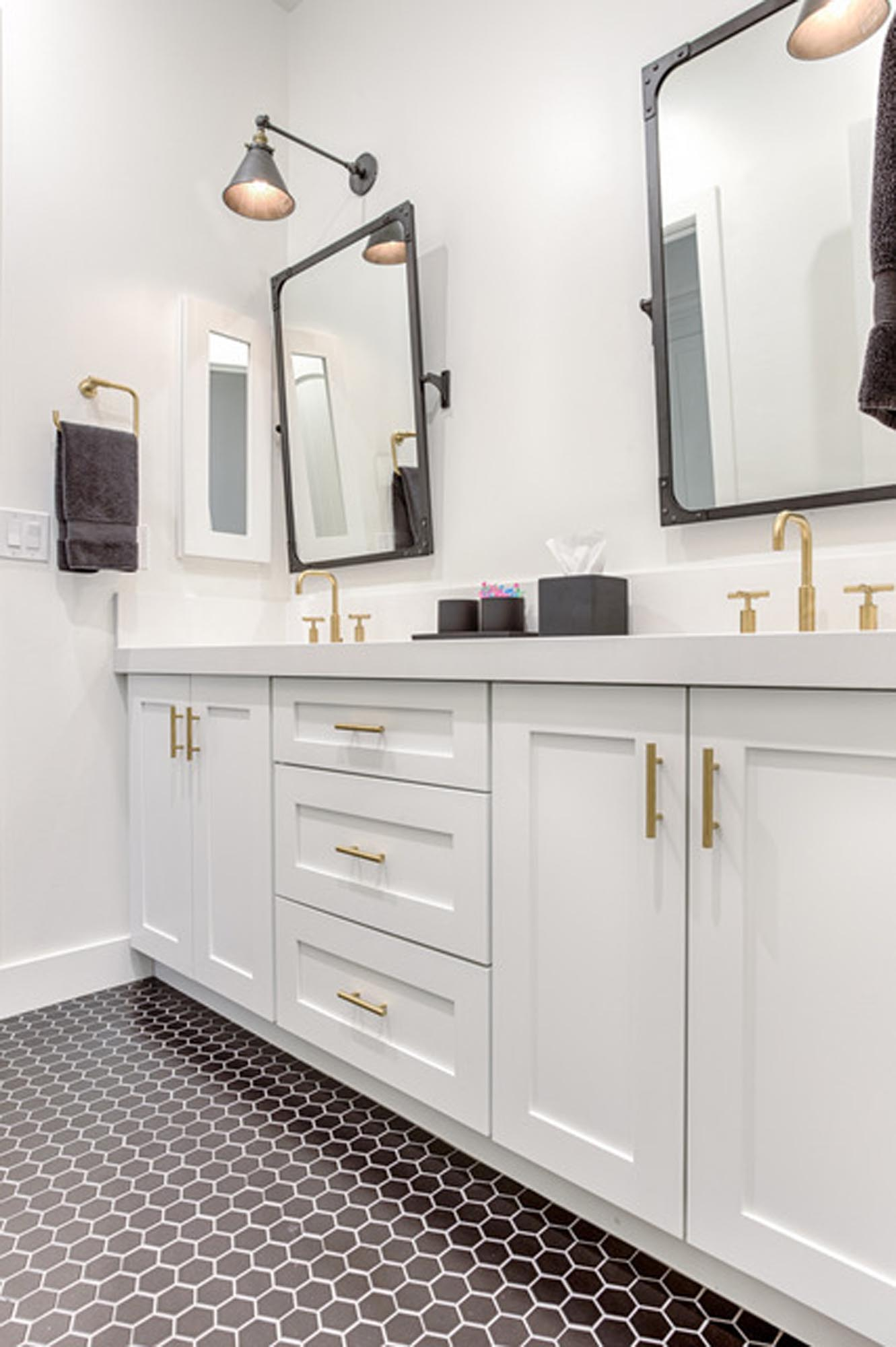 White countertop sink with mirrors and lights