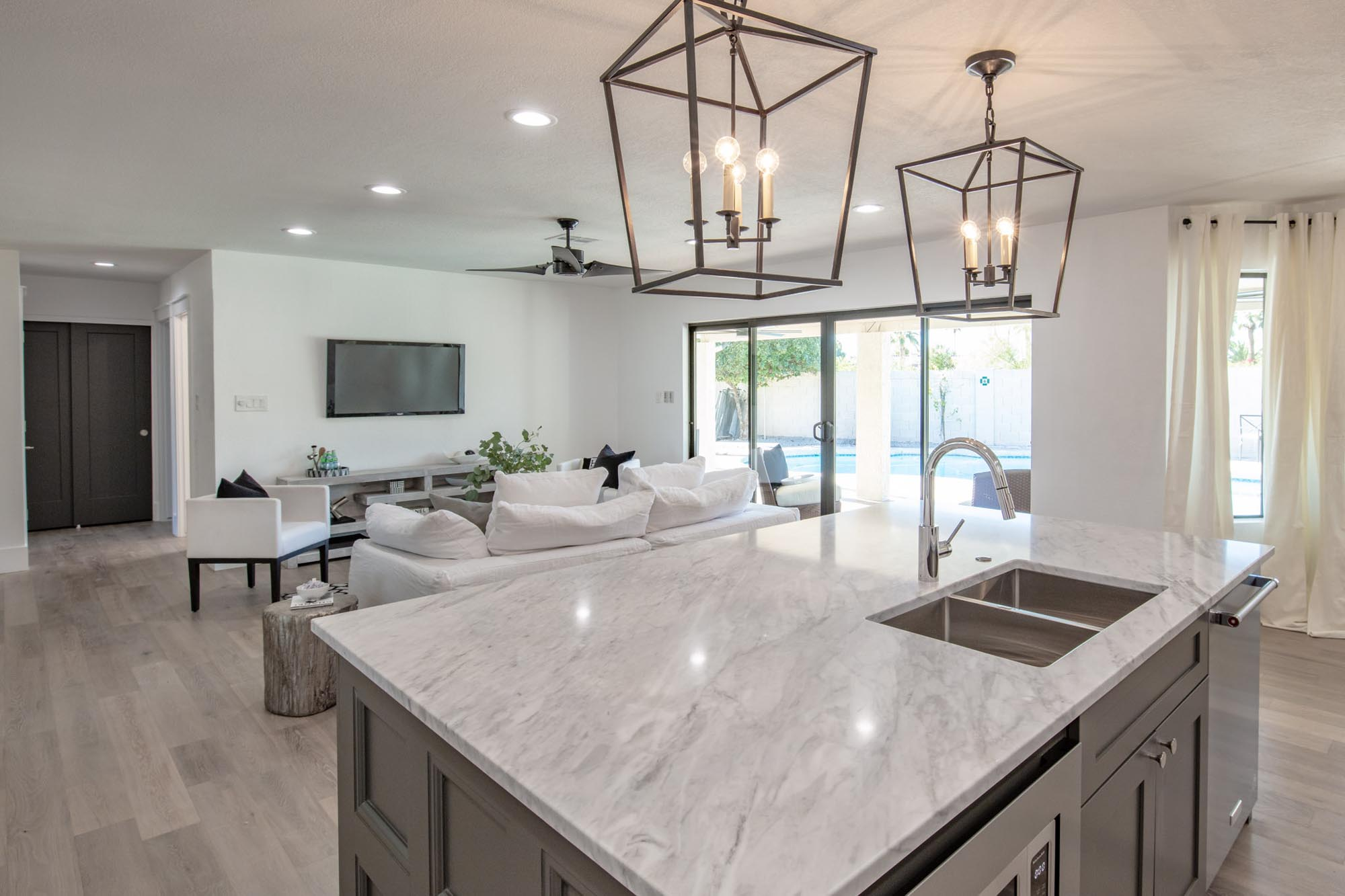Kitchen area with granite countertop island and stylish hanging lights