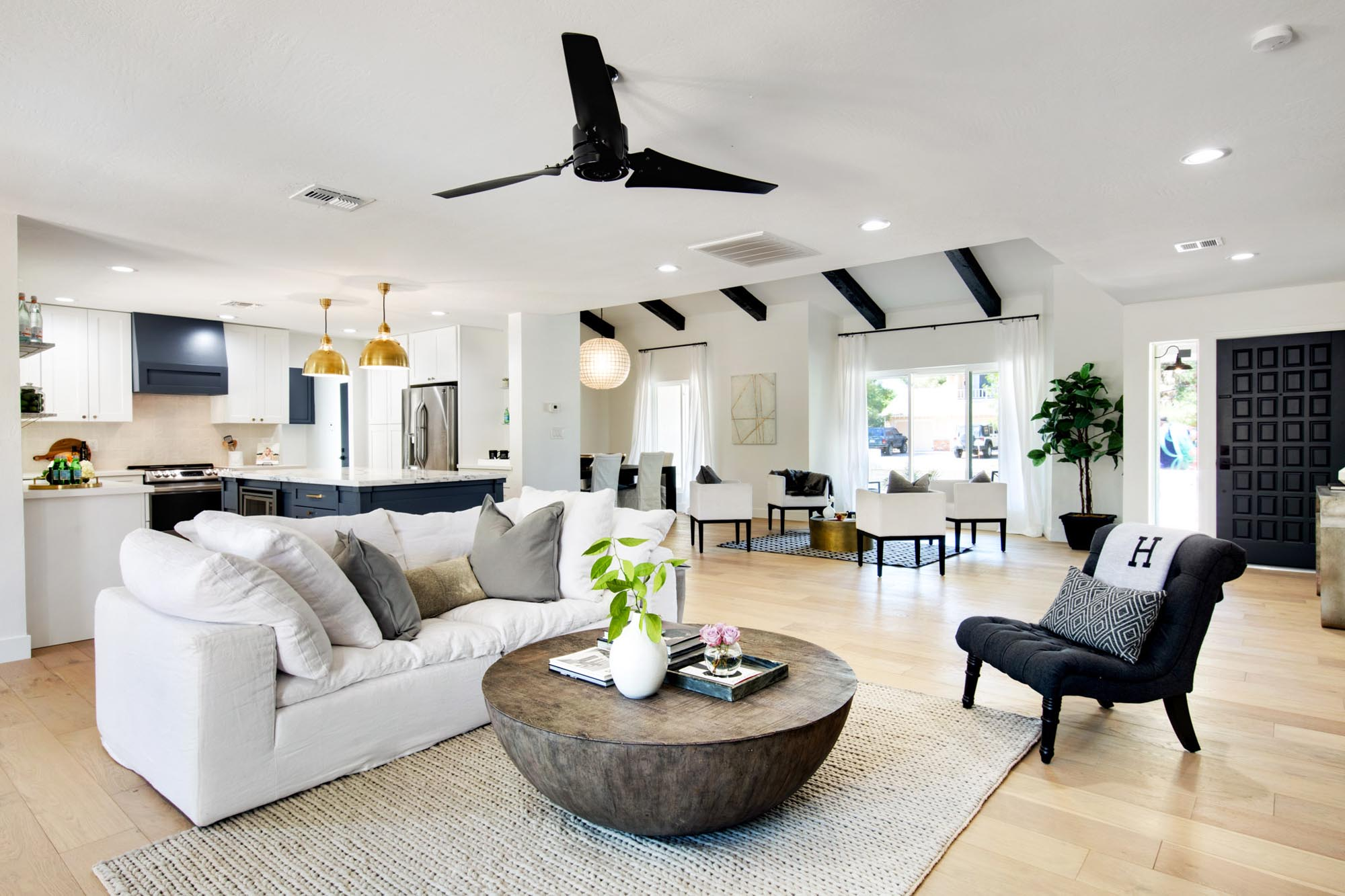 Modern living room white sofa and wooden center table on knitted carpet