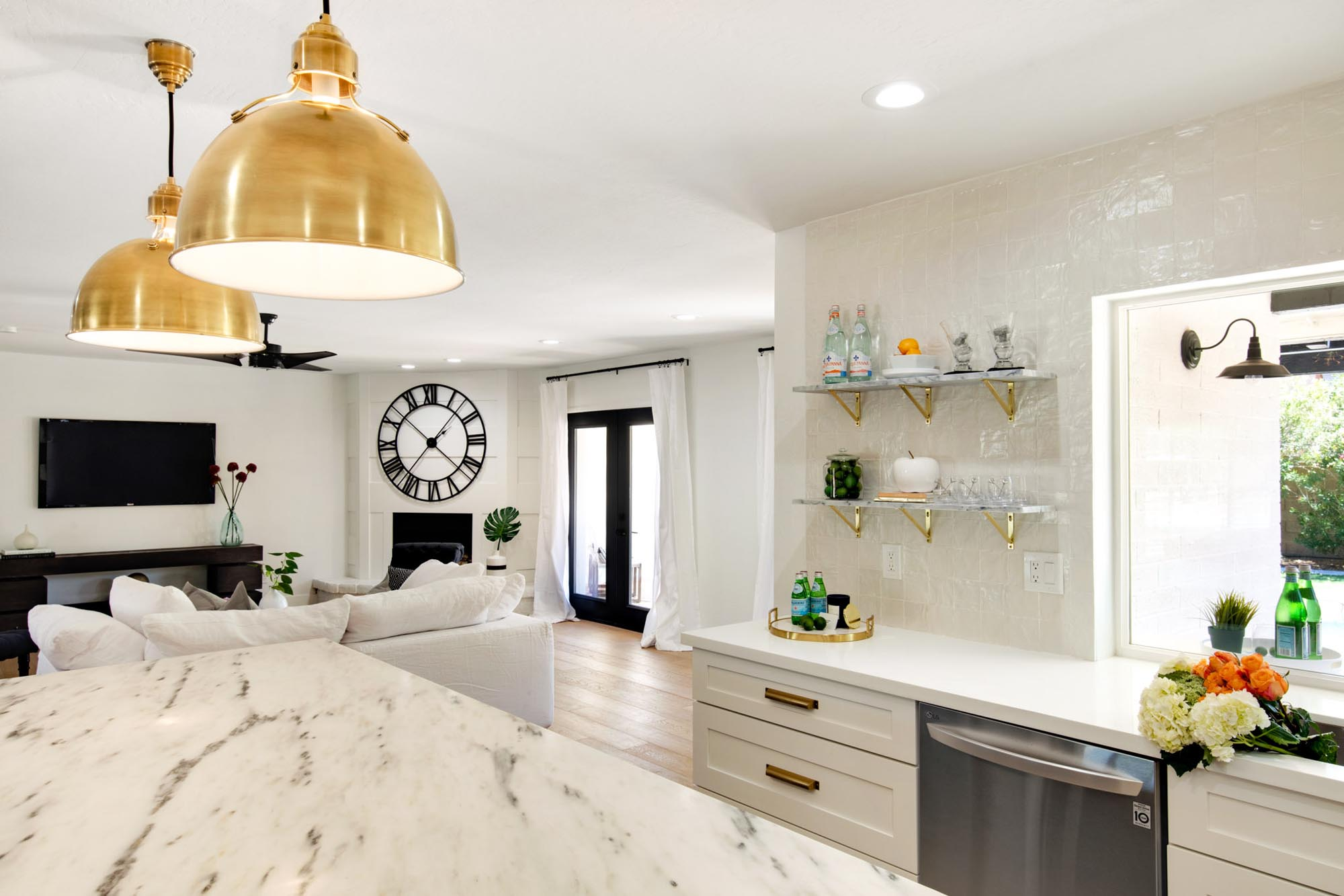Kitchen with stylish gold hanging lights