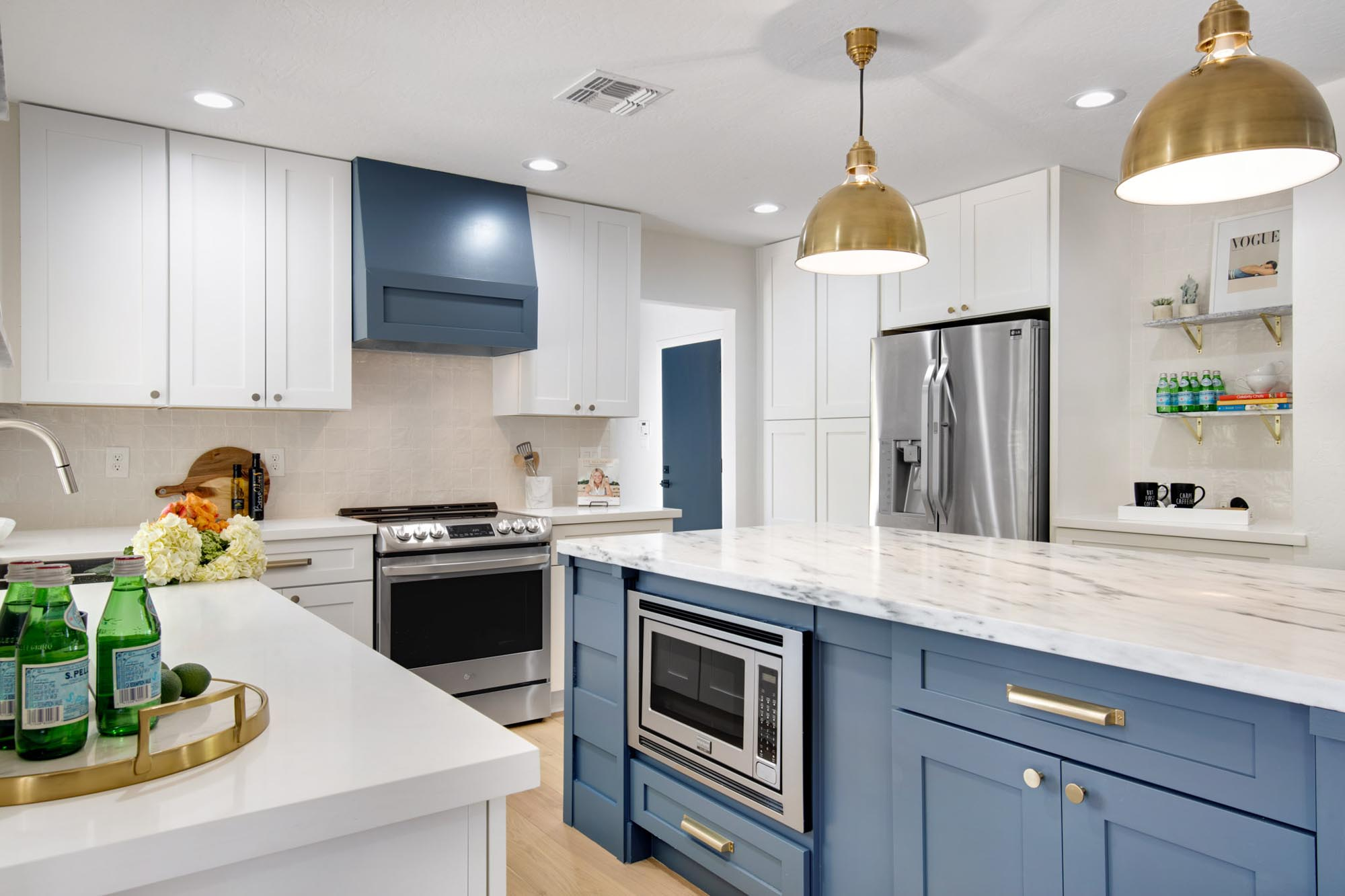 Modern kitchen with appliances and white countertops sink