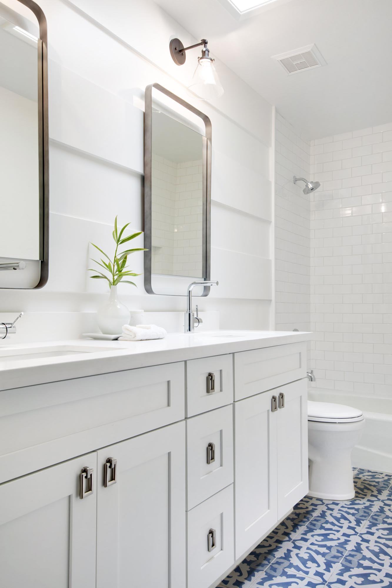 White toilet room with sink and mirrors