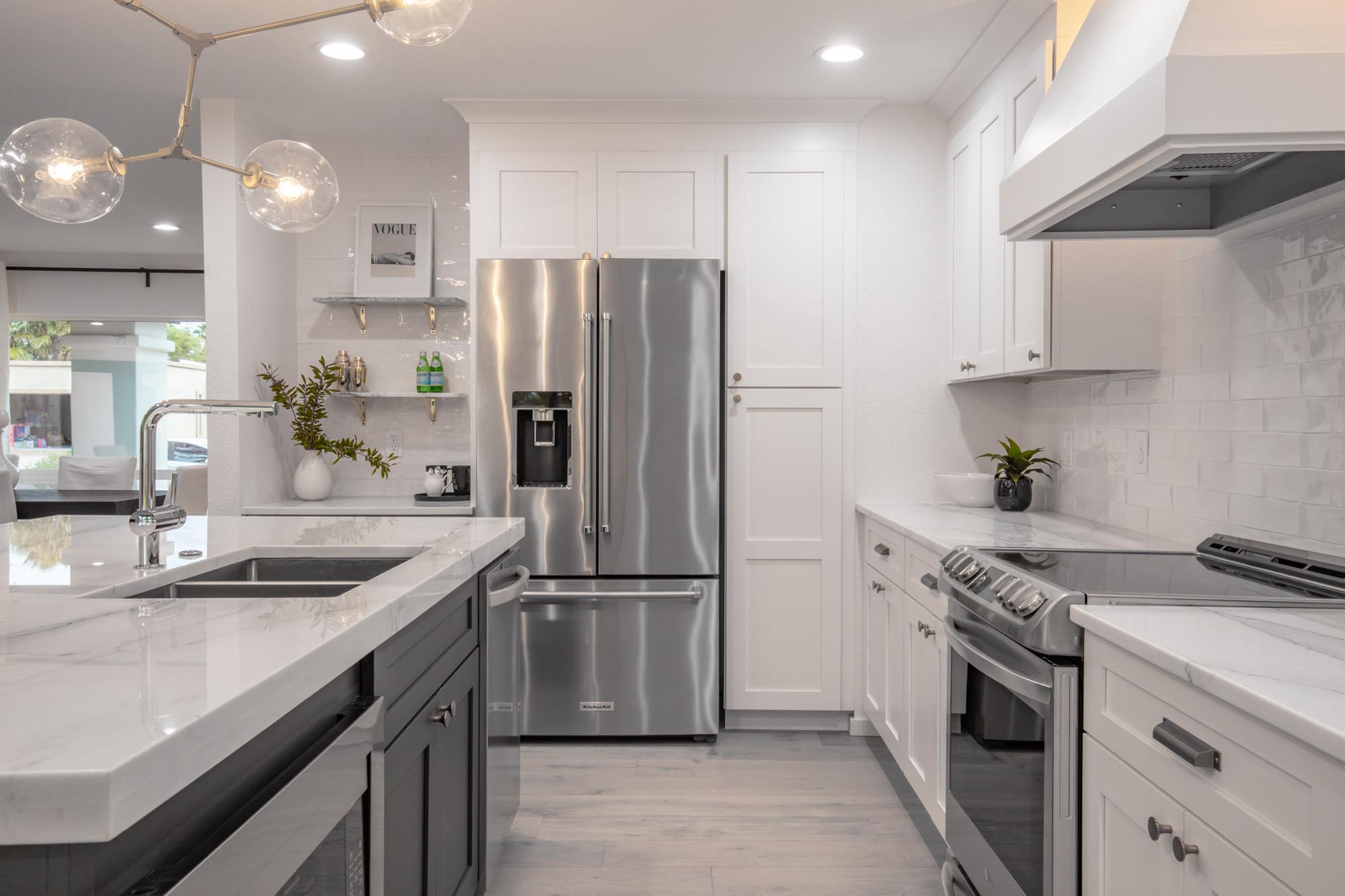 Kitchen with appliances and white cabinets