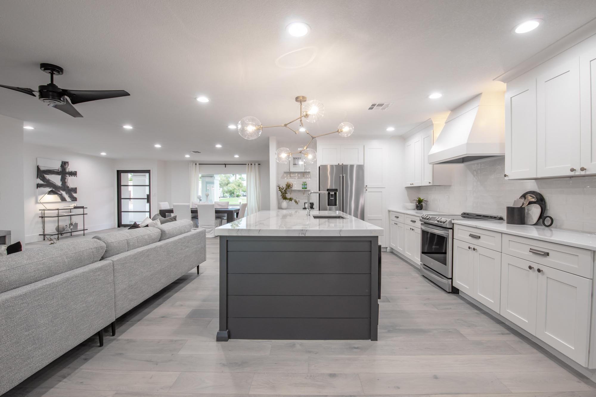 Kitchen area with island and white cabinets