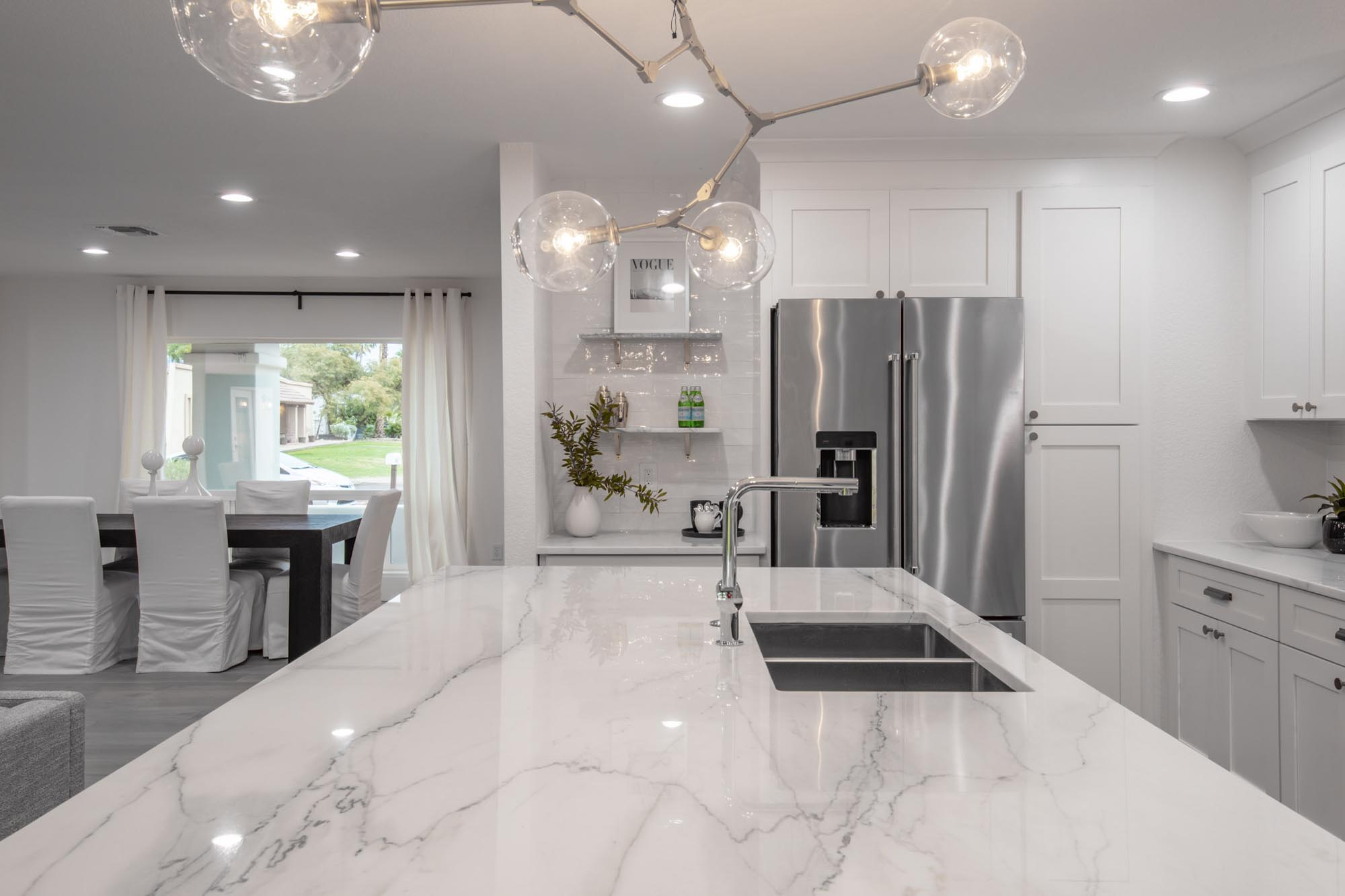 Kitchen white countertops island sink and faucet