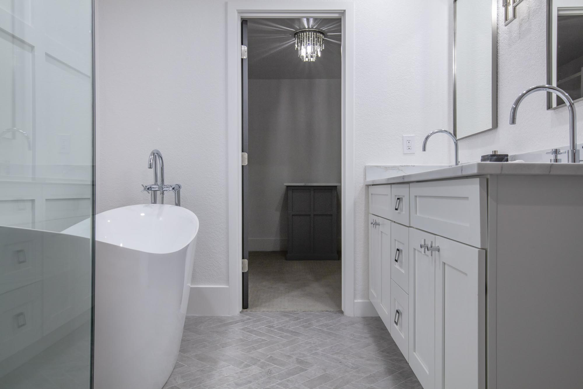 Bathroom entryway with chandelier
