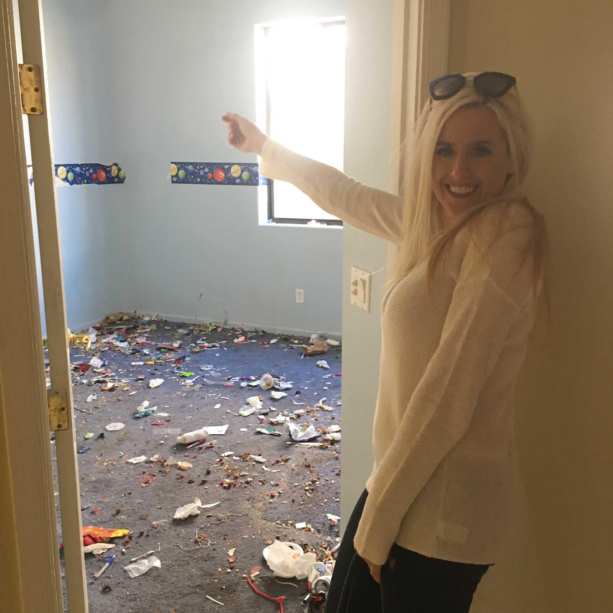 Woman standing beside the room door
