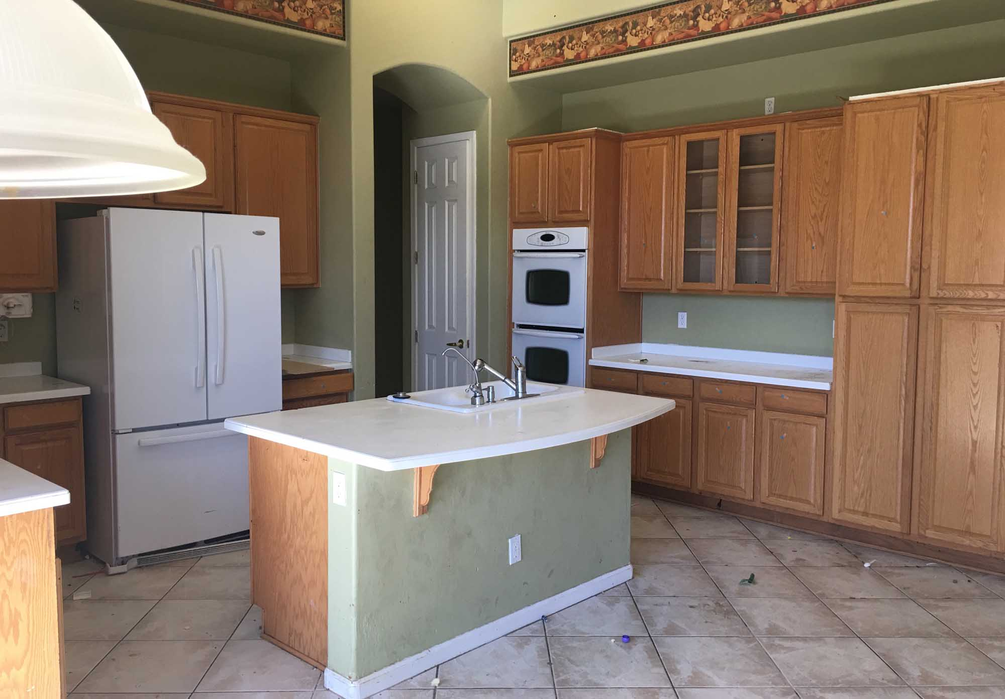Old kitchen design large cabinet and white appliances