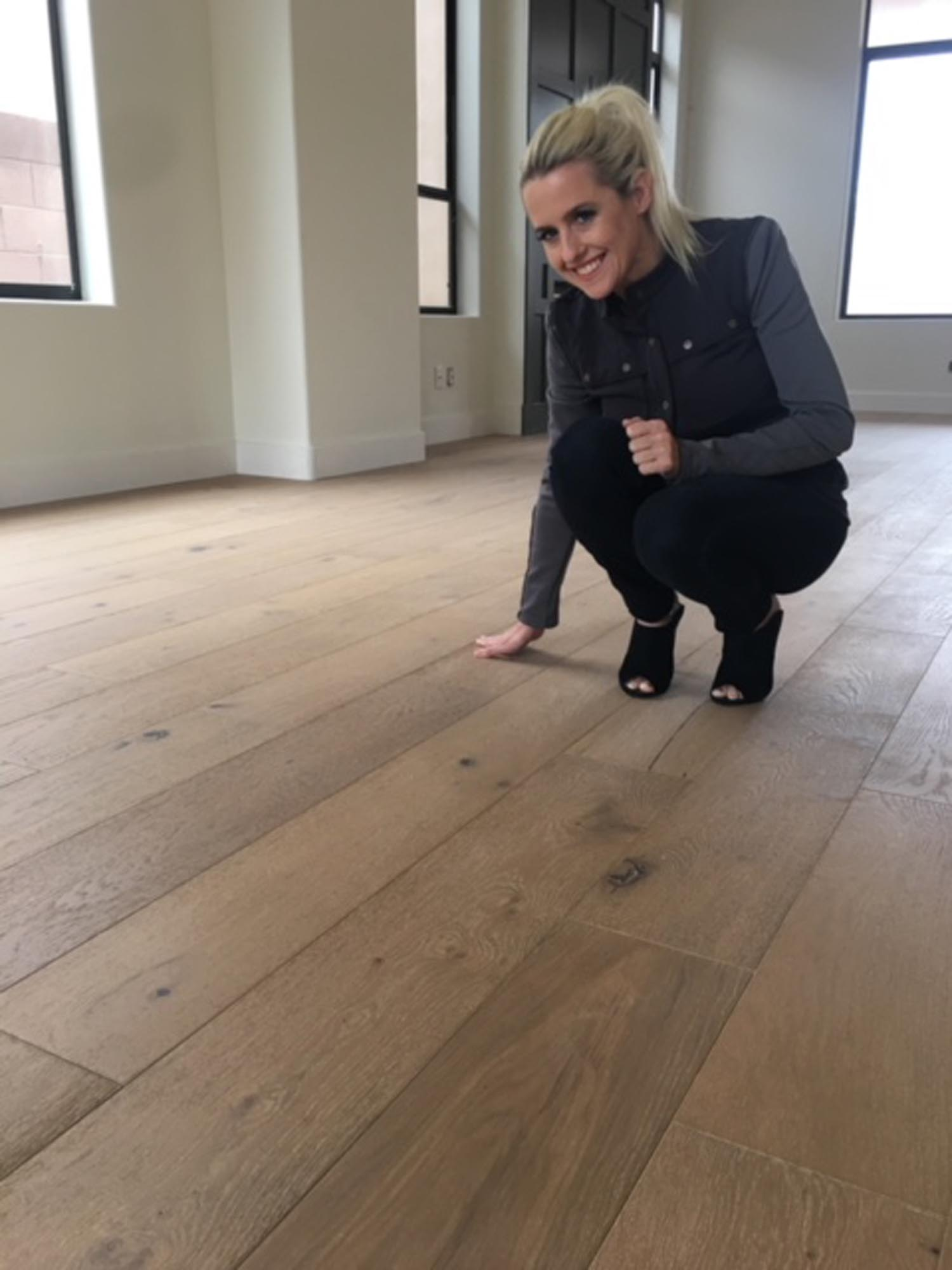 Woman touching the wooden flooring