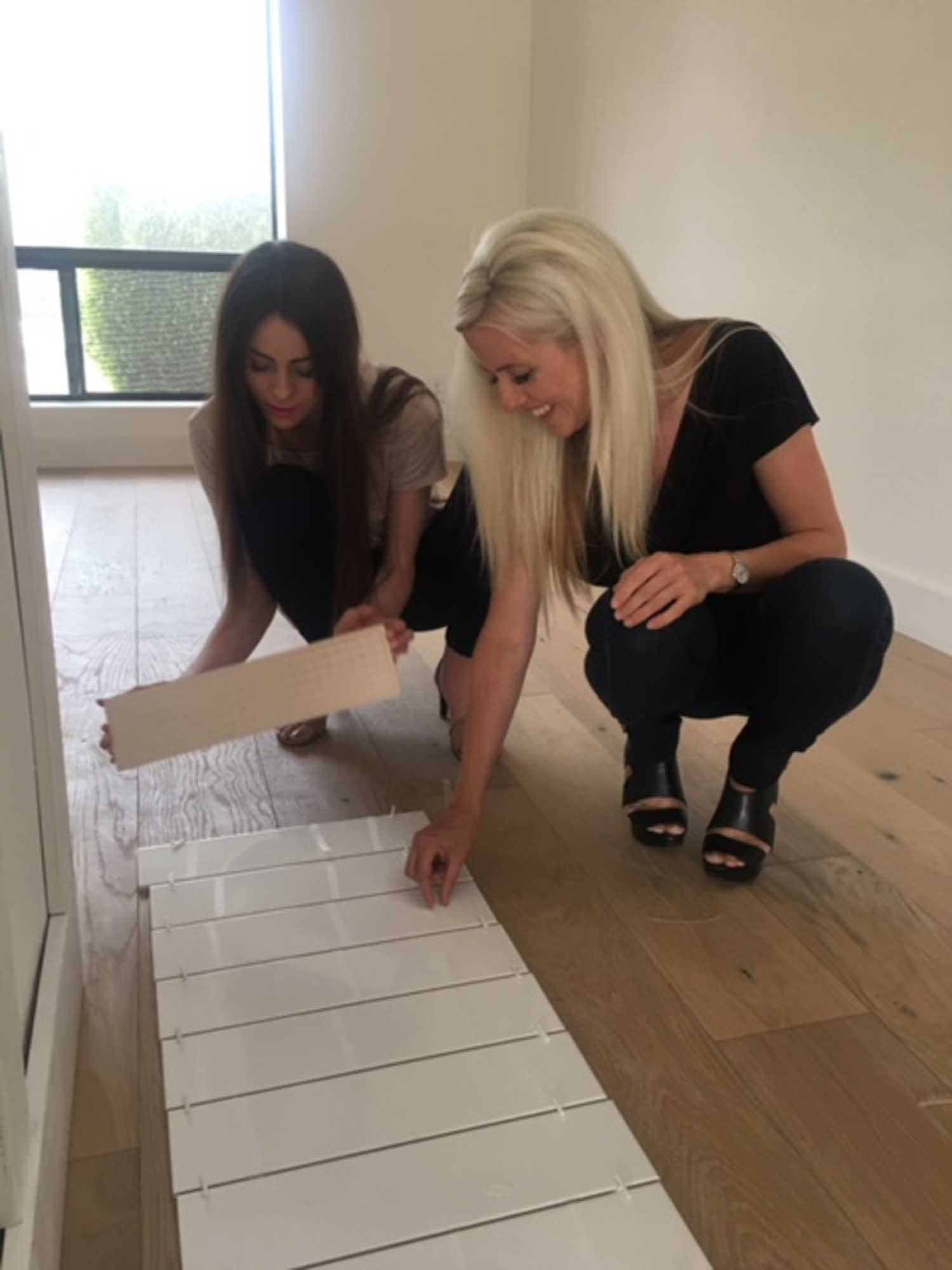 Two women working together in assembling tiles