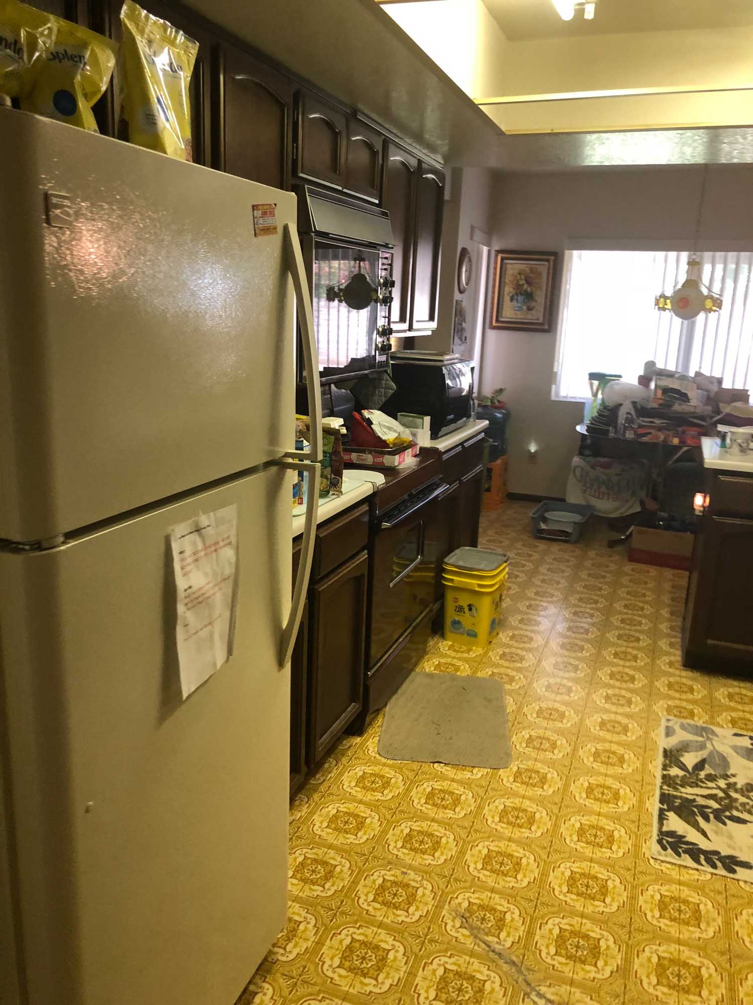 Kitchen area with old  refrigerator
