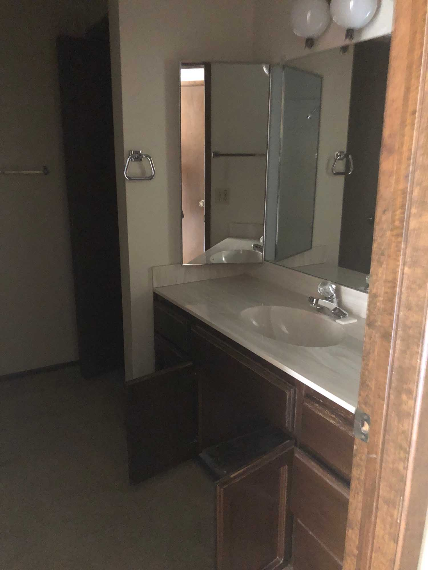 Old sink and faucet with mirror