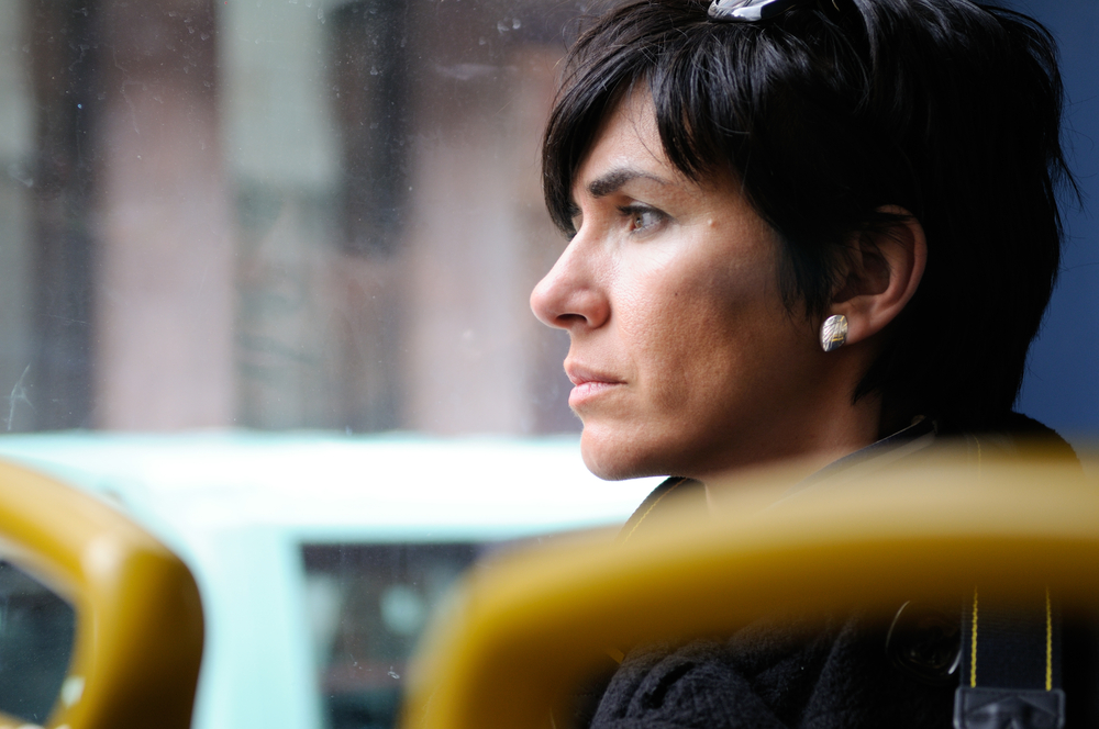woman on bus looking out the window shutterstock.jpg