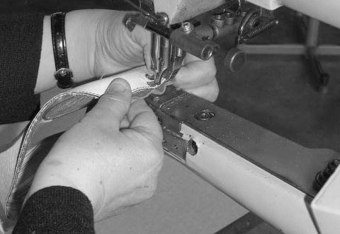 SEWING ON CALVES LEATHER SOLE.jpg
