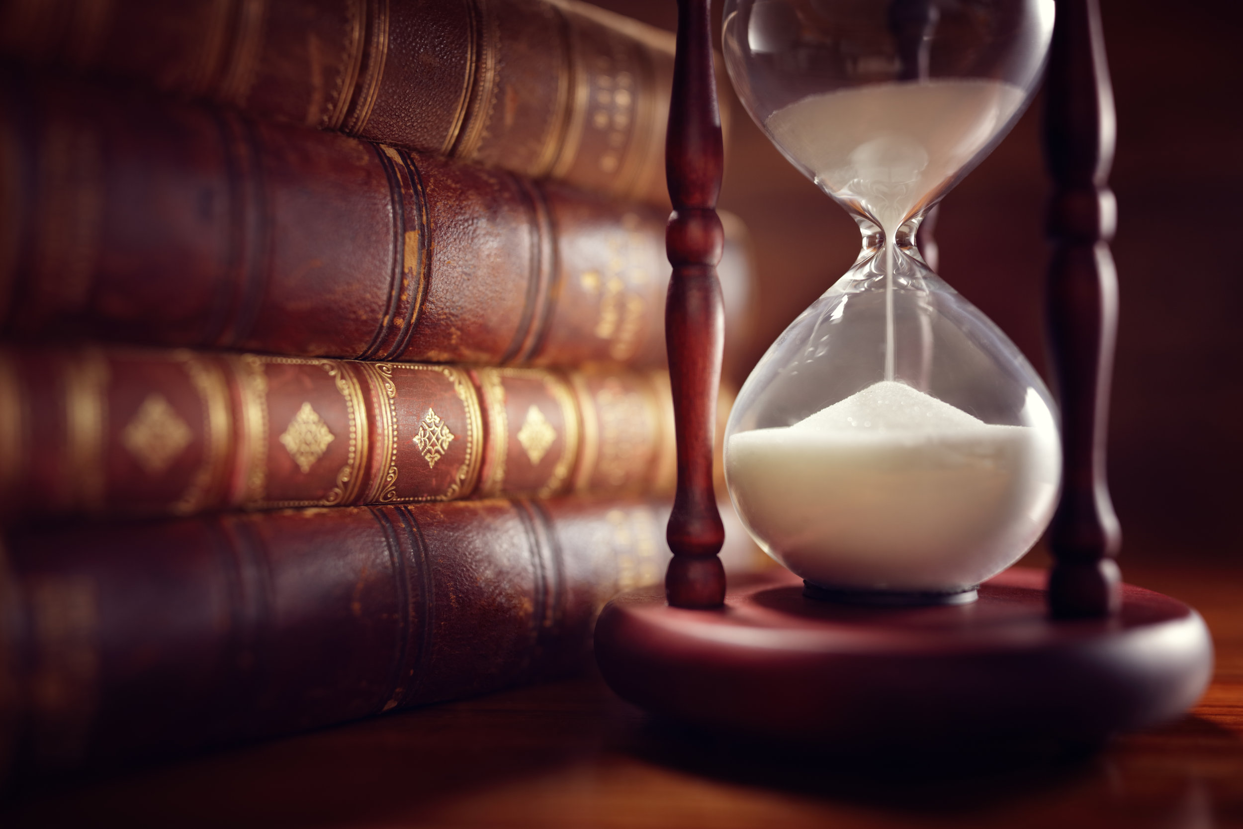 old-books-and-hourglass-P4AQDYZ.jpg